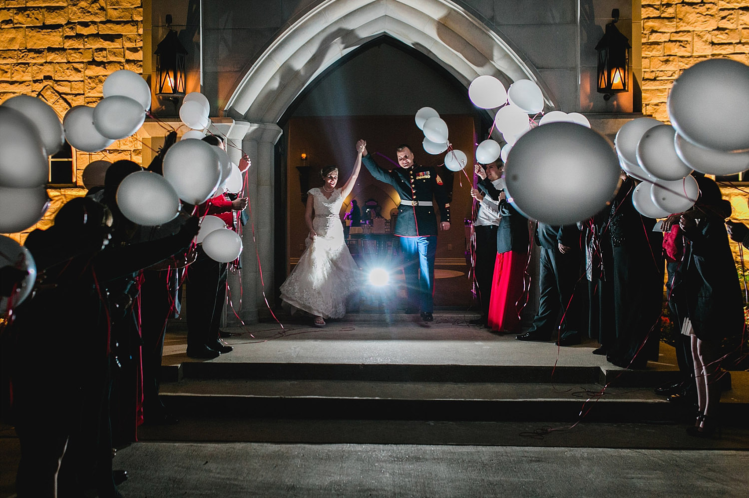 Castle at Rockwall wedding bride and groom exit with LED balloons