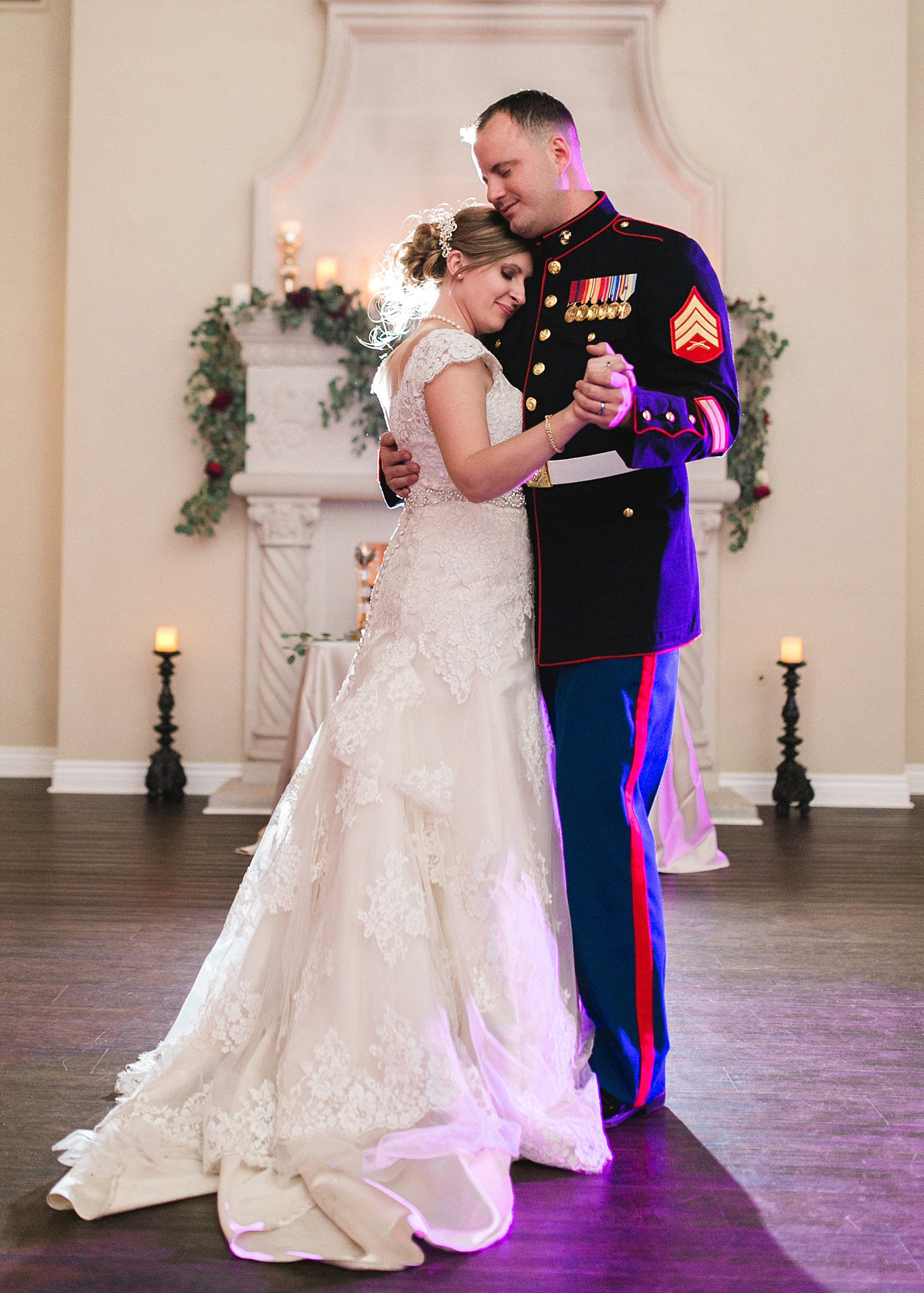 Castle at Rockwall wedding bride and marine groom dancing in front of fireplace