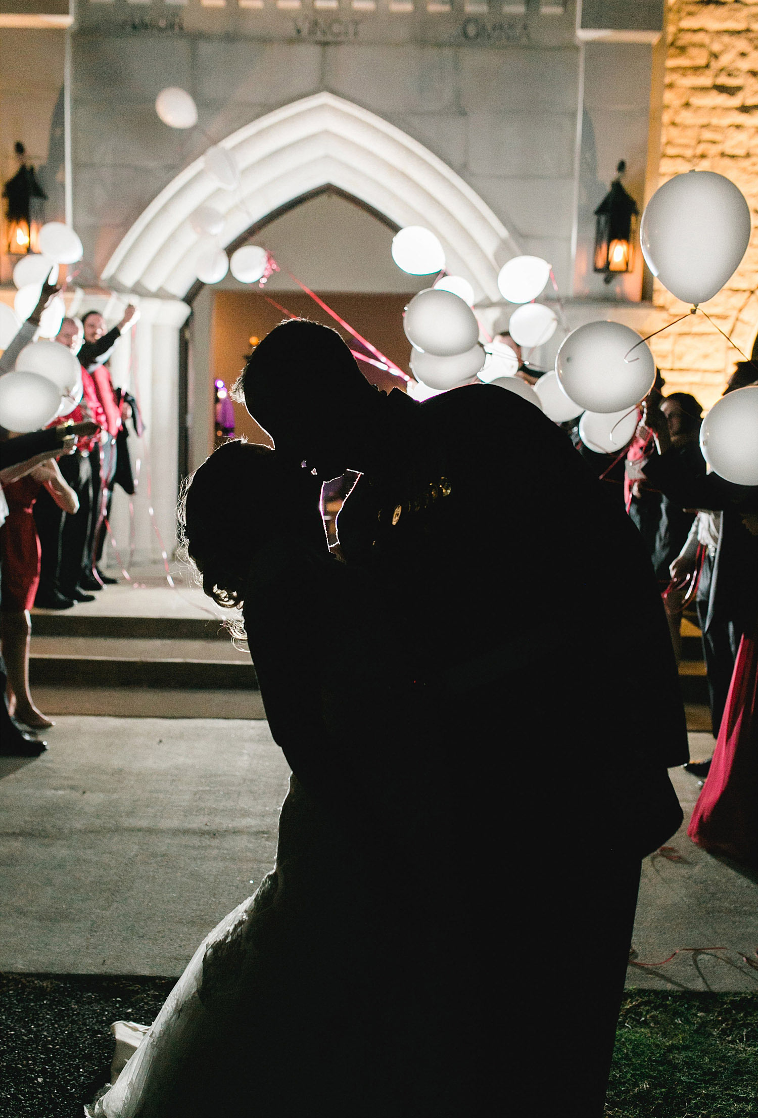 Castle at Rockwall wedding bride and groom kissing with LED balloons in the background