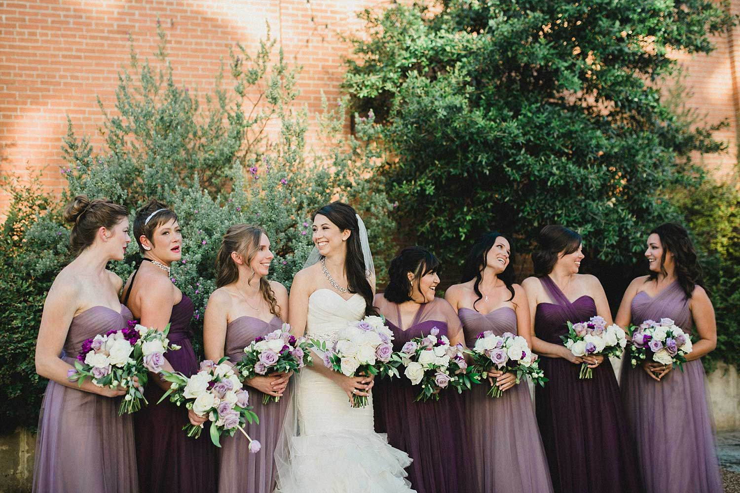 809 at Vickery wedding bridesmaids in lavender and purple bridesmaid dresses in courtyard