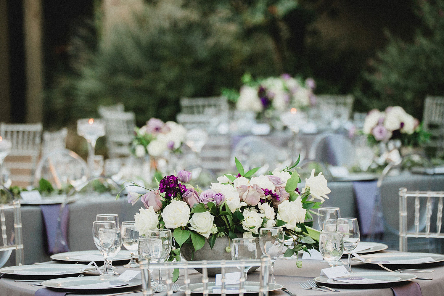 809 at Vickery wedding purple and lavender flowers in concrete boat vases and clear chairs
