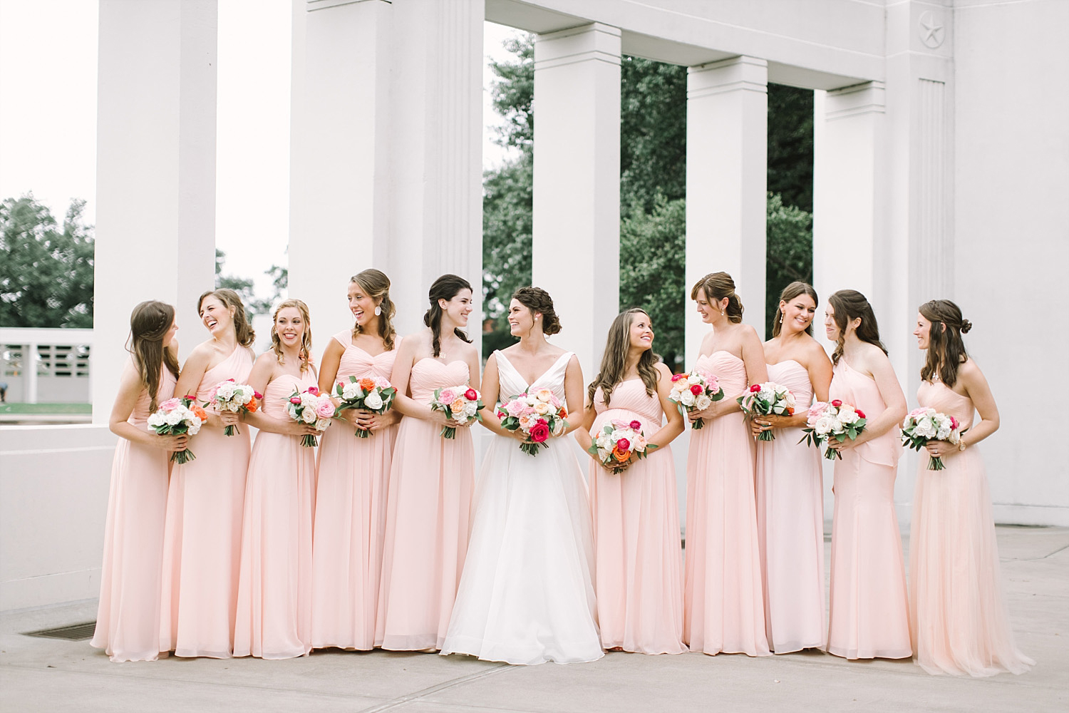 Old Red Museum bridesmaids in blue dresses holding colorful pink orange and white bouquets