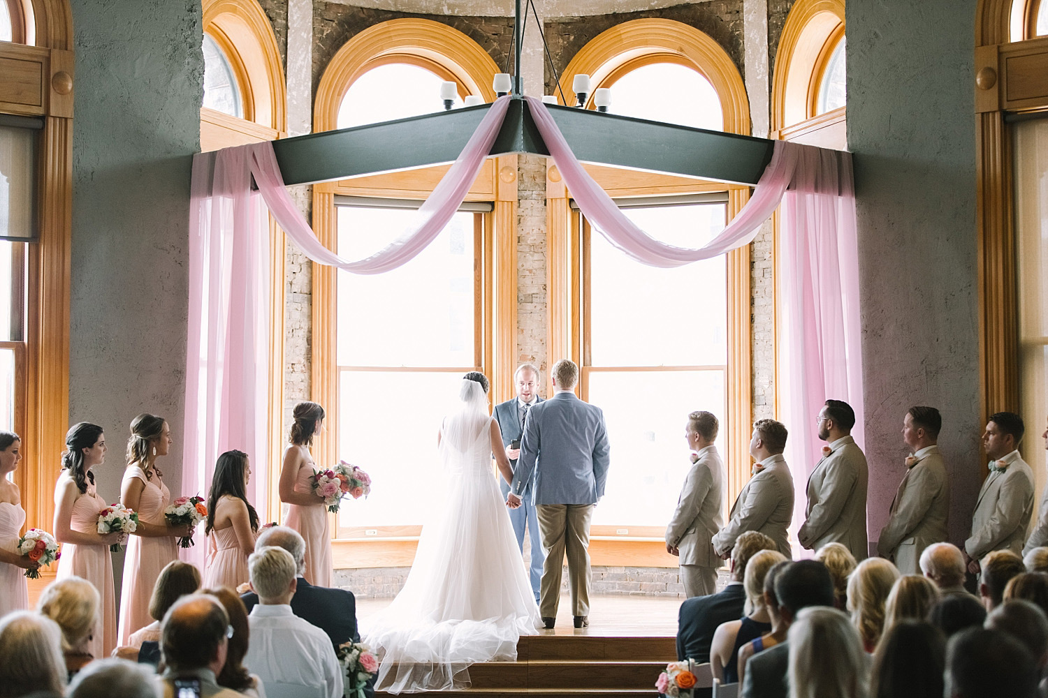 Old Red Museum wedding ceremony with blush fabric at altar