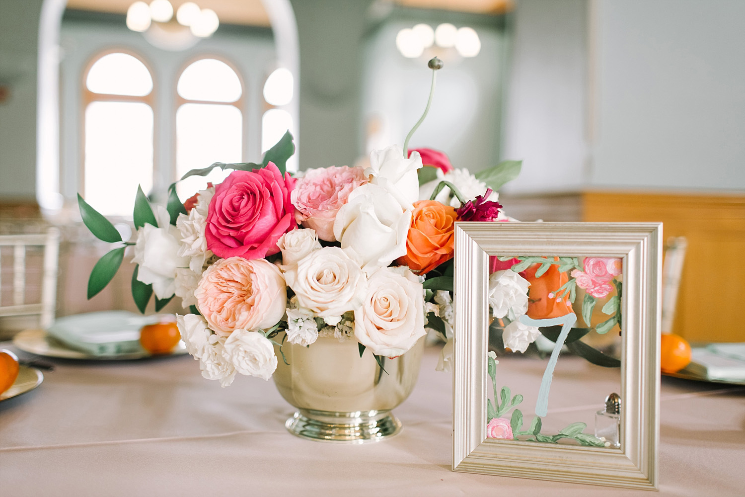 Old Red Museum wedding reception flower painted frame table numbers and pink orange blush flowers