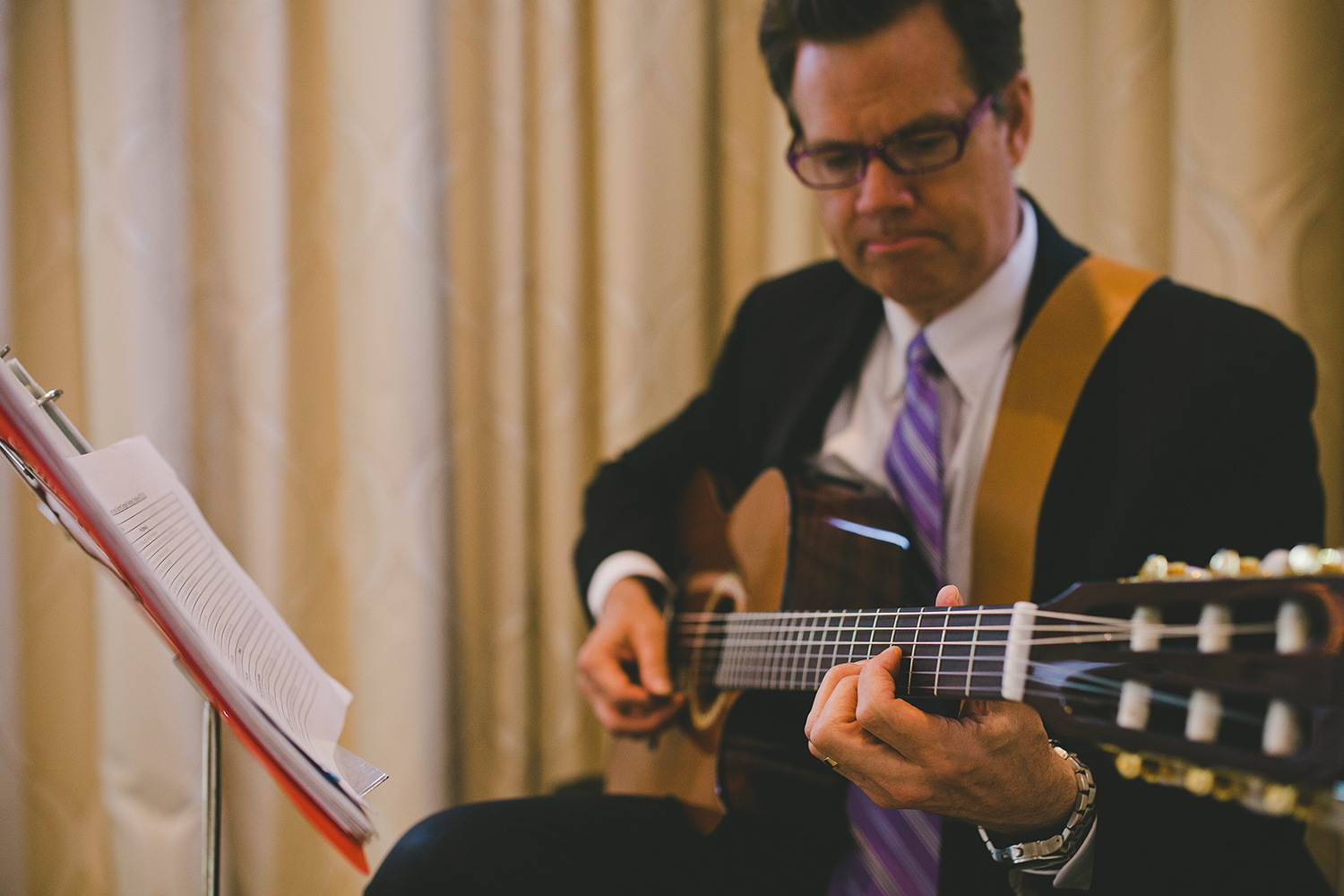 Ceremony musician playing the guitar at a ballroom wedding