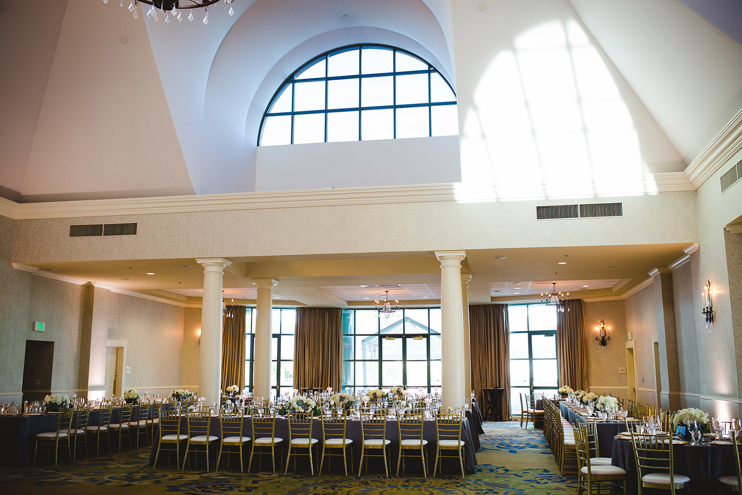 River Crest Country Club interior ballroom reception with tall arched ceilings