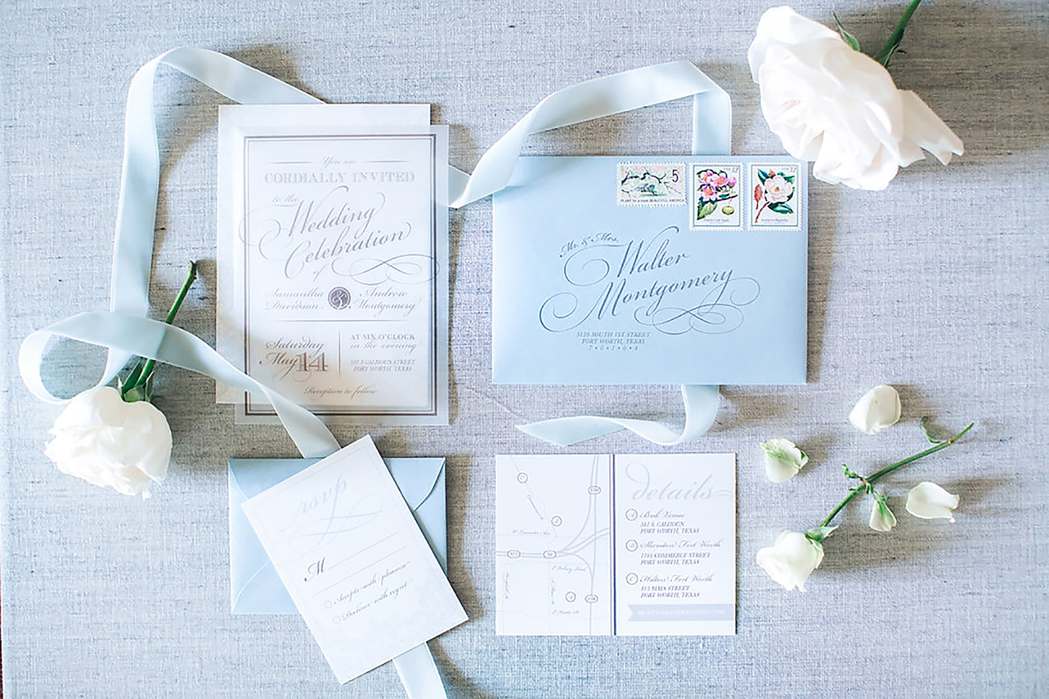 Dusty blue and acrylic wedding invitation with white flowers
