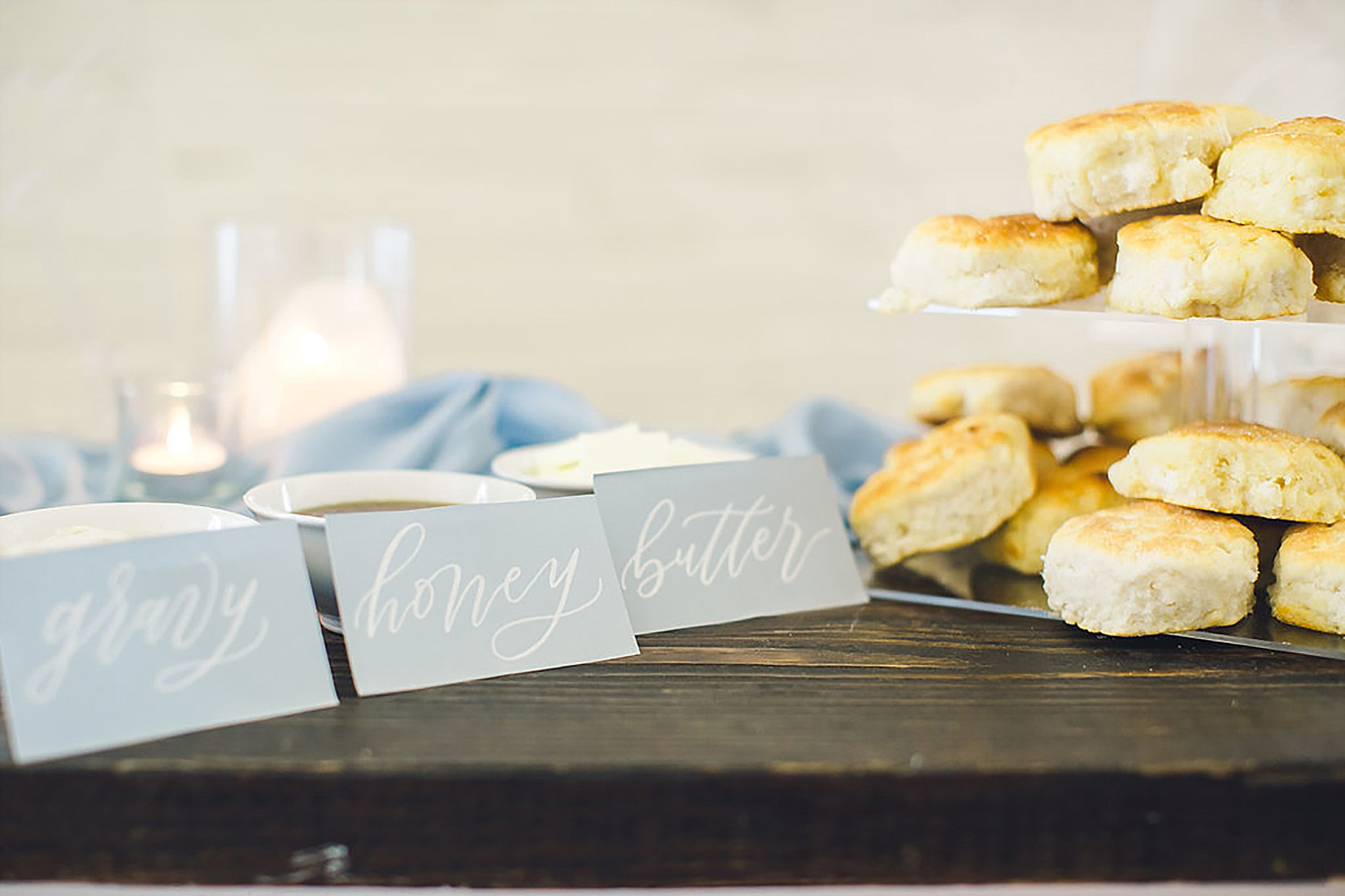 Southern bicuit bar biscuit on a acrylic stand and honey butter and gravy