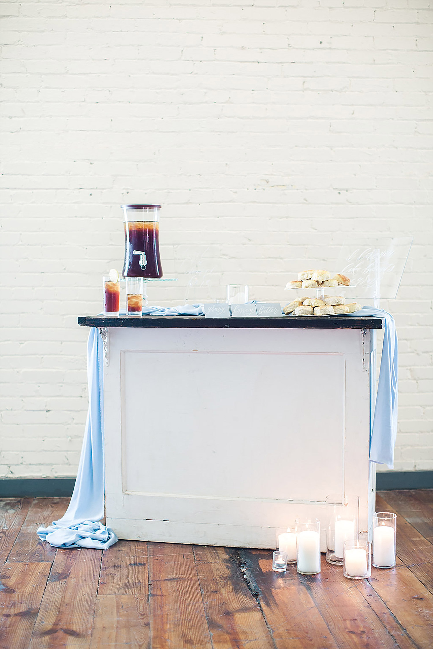 Southern wedding biscut bar with acrylic signage and sweet tea at the Brik Venue in Fort Worth.