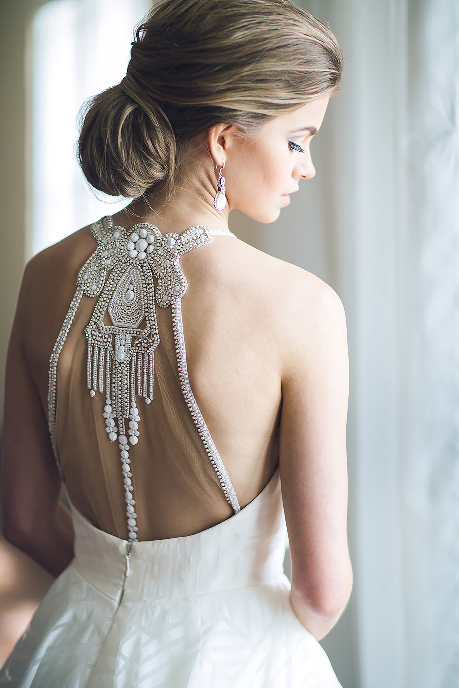 Bride wearing Haley Paige dress with a crystal back with a southern updo