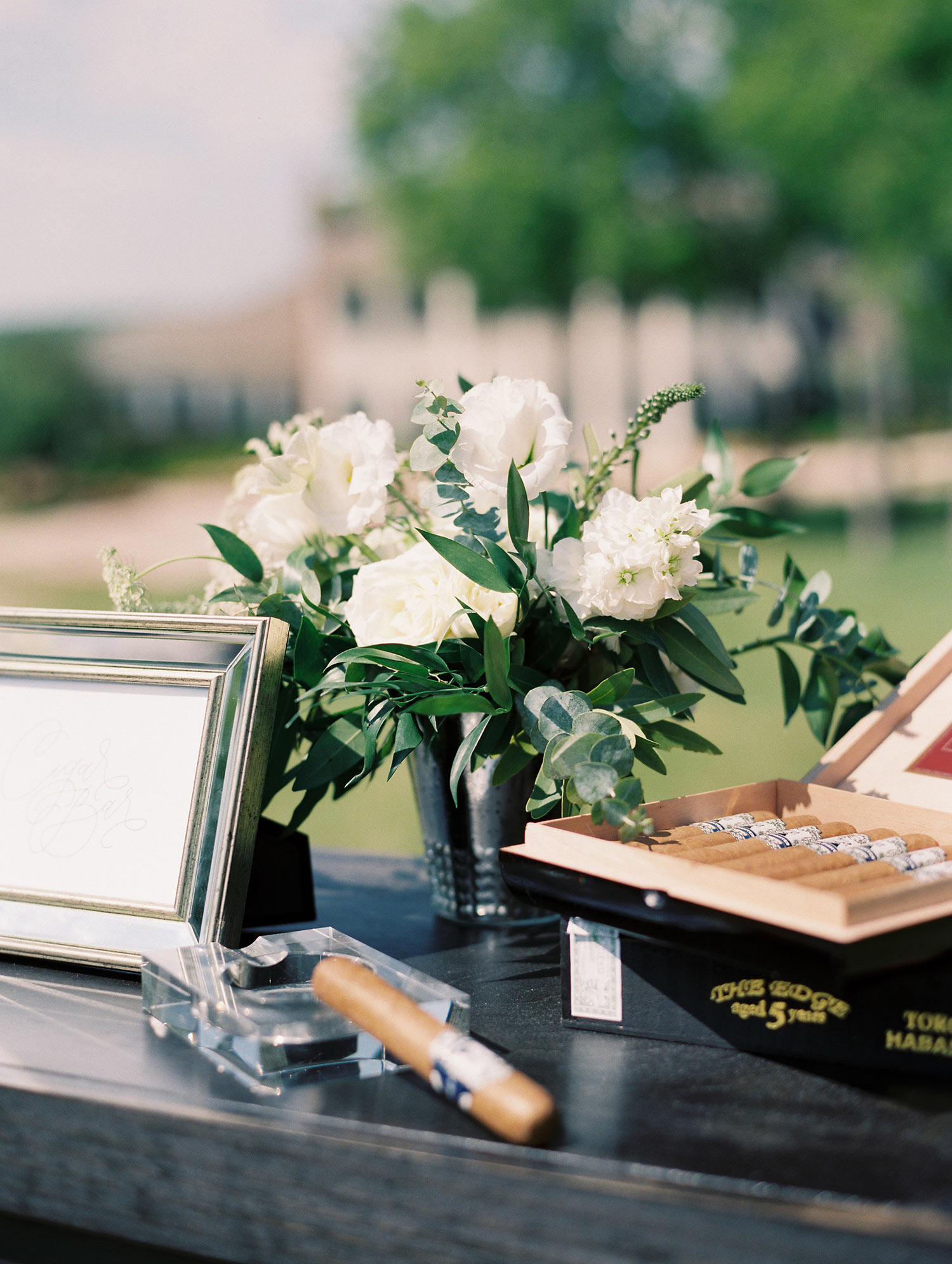 Cigar resting on crystal ash tray at wedding cigar lounge