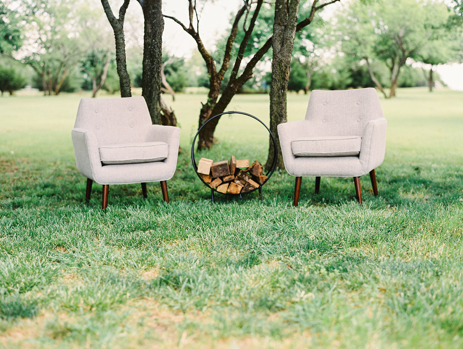 Winter wedding seating lounge with firewood in round hoop