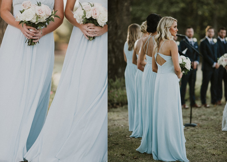Light blue bridesmaid dresses holding blush flowers
