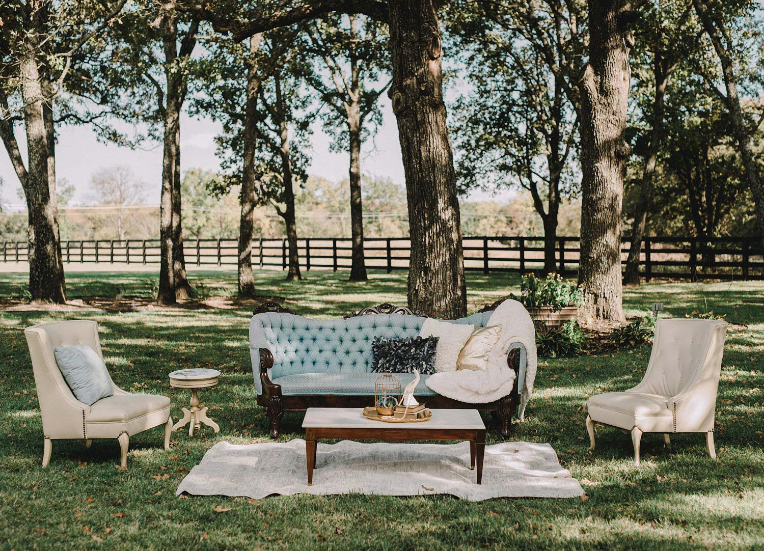 This outdoor blue and white wedding lounge at White Sparrow Barn was perfect for this barn wedding.