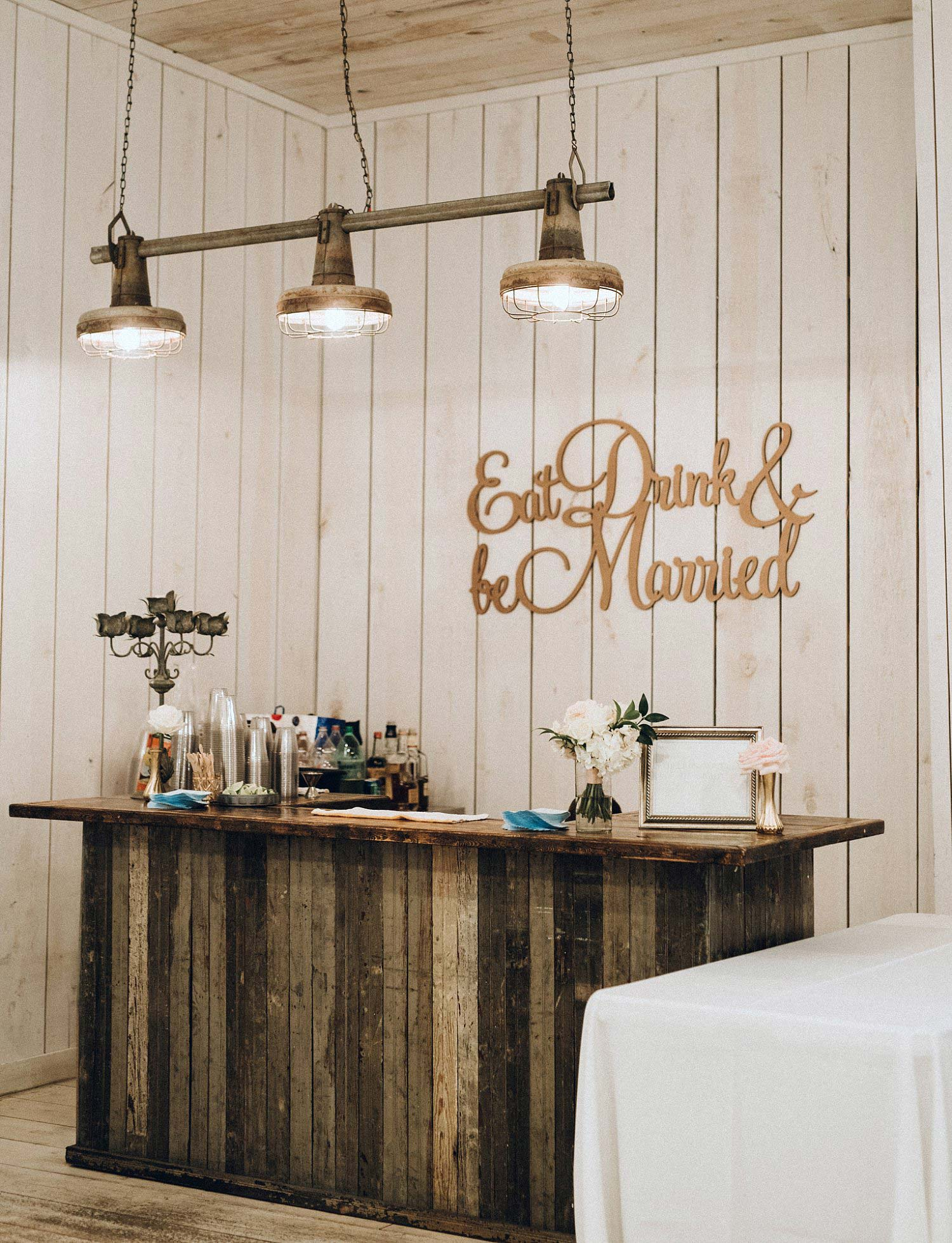 Wood bar with laser cut signage and shiplap walls