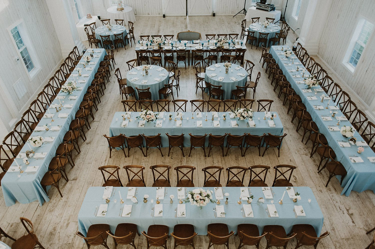 White Sparrow Barn wedding reception with long and round blue tables and dance floor