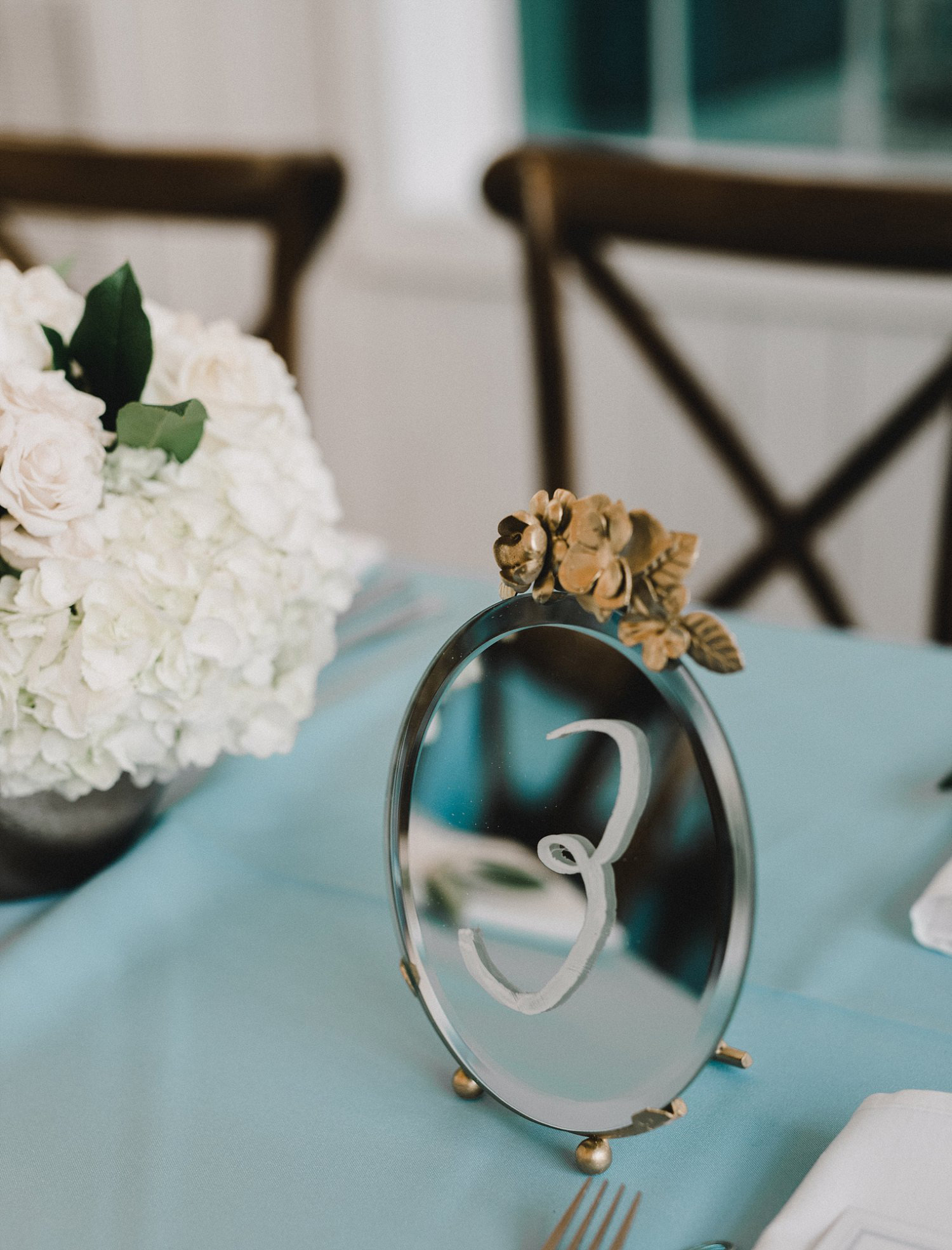 Vintage gold mirror table number for White Sparrow Barn wedding