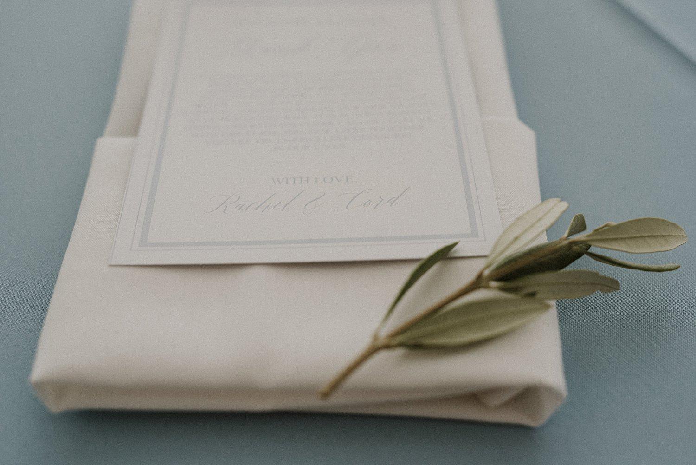 Olive branch on folding napking and menu