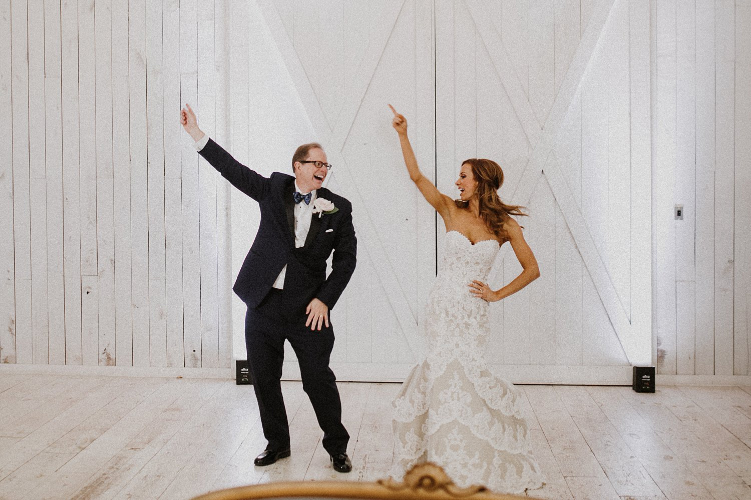 Fun father daughter dance with white shiplap