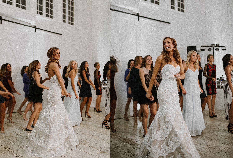 Bride dancing with cheerleaders