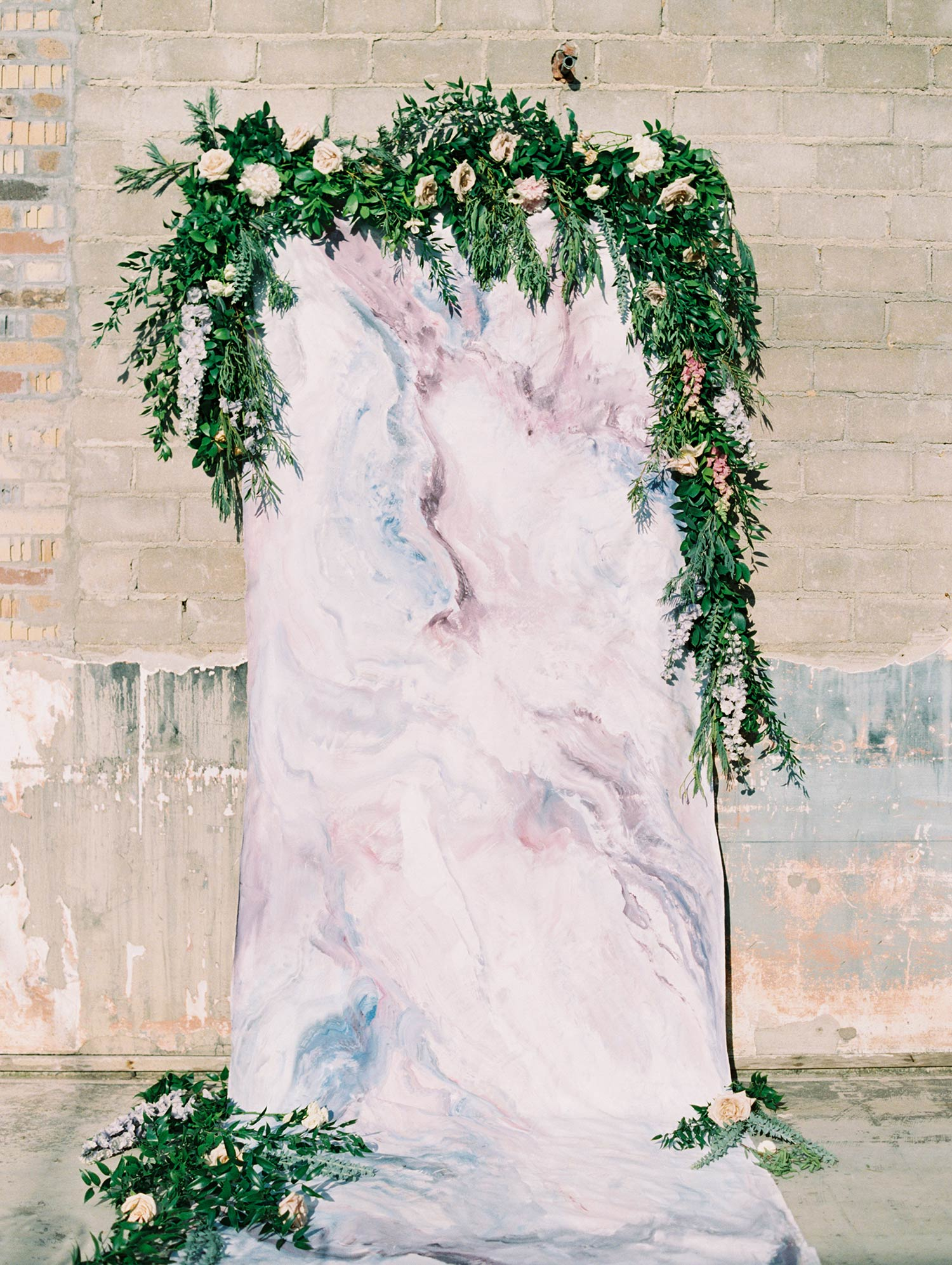 Marble moody backdrop for a wedding with greenery