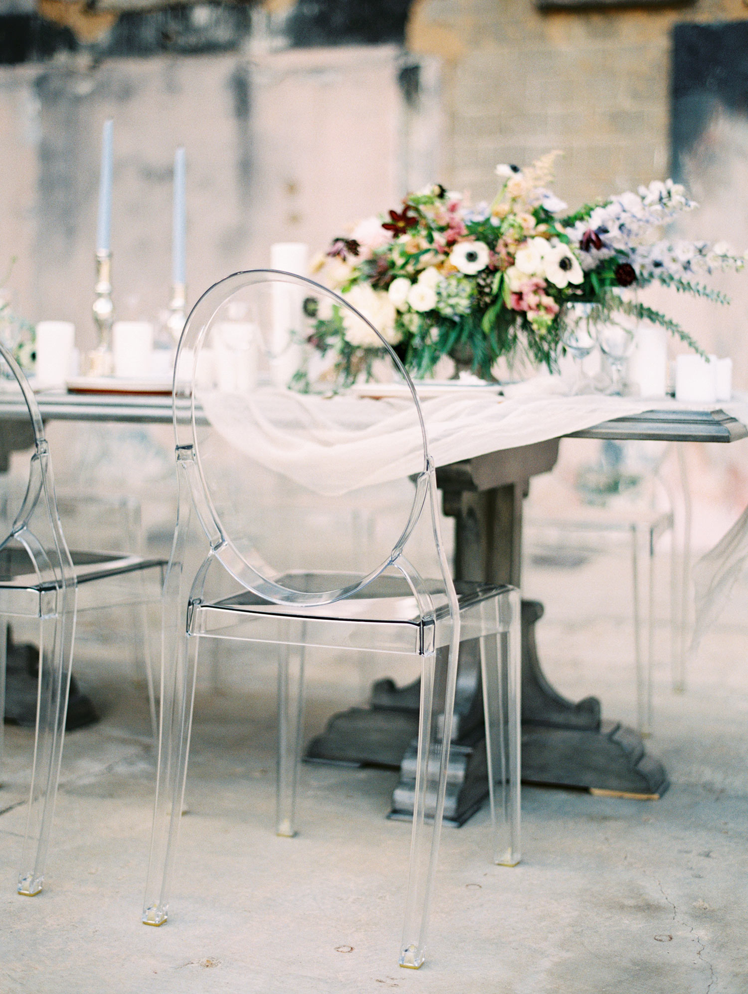 Grey farm table with ghost chairs