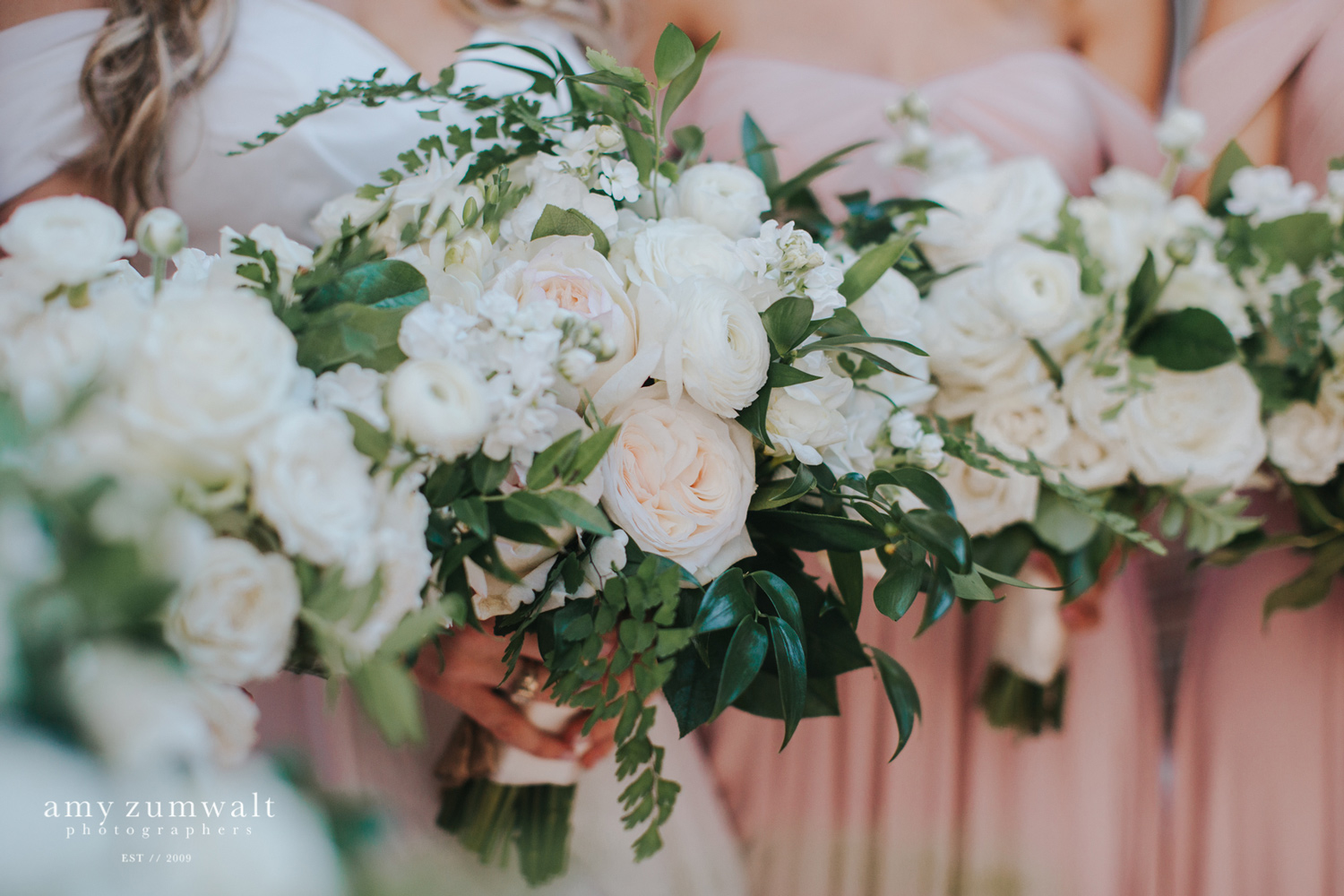 White bouquets with lush greenery