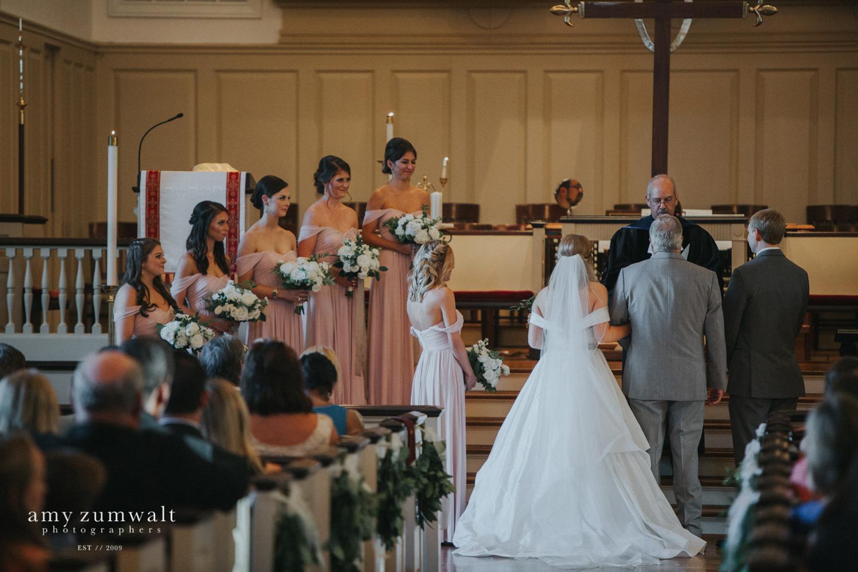 Bridesmaids in mauve bridesmaid dresses at first presbyterian church tyler
