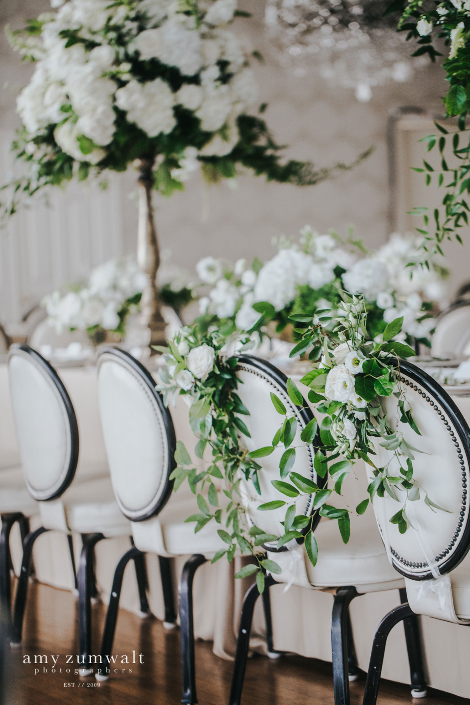 Head table with white and green flowers on champagne linen