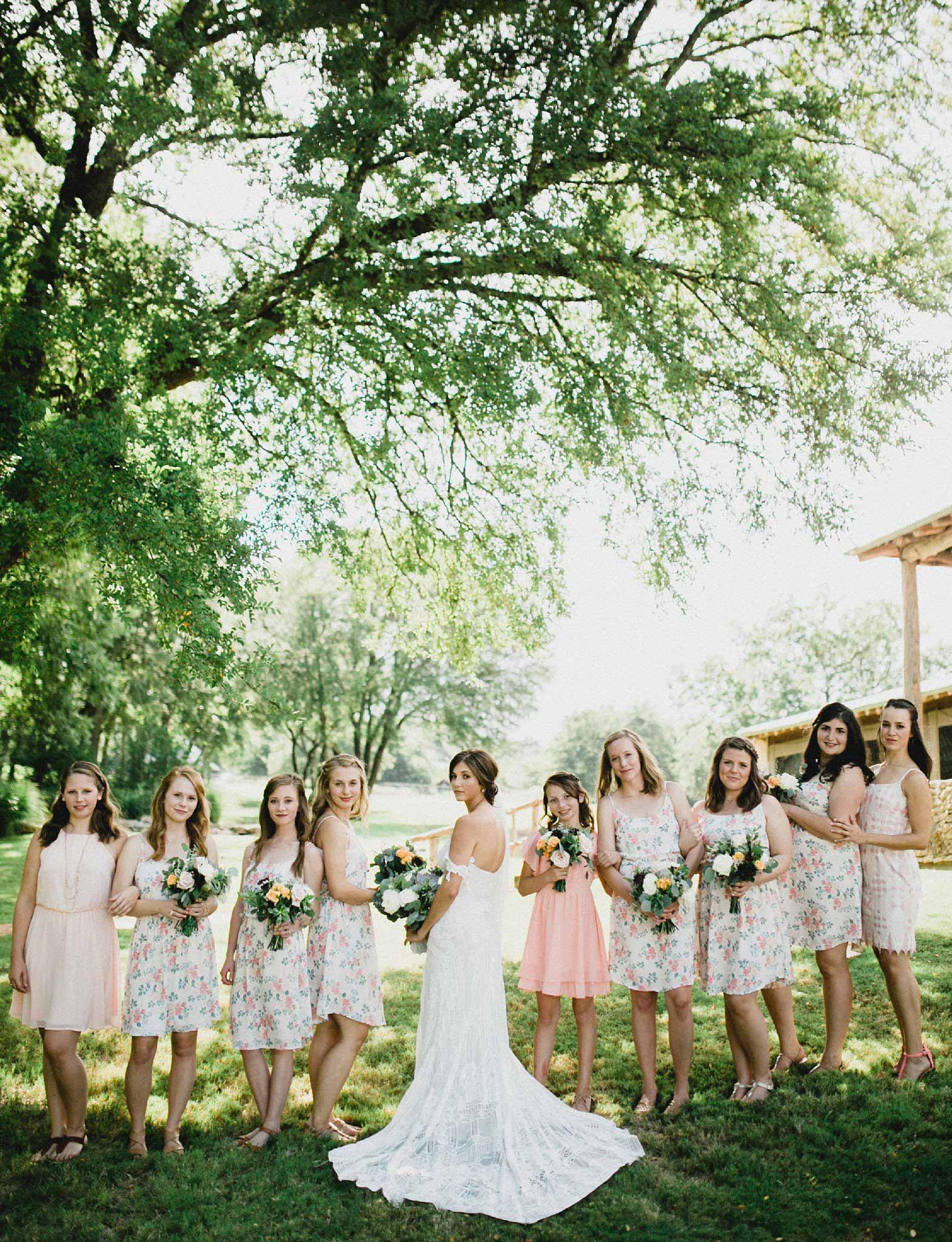 Bridesmaids where short floral print dress for a summer rustic wedding