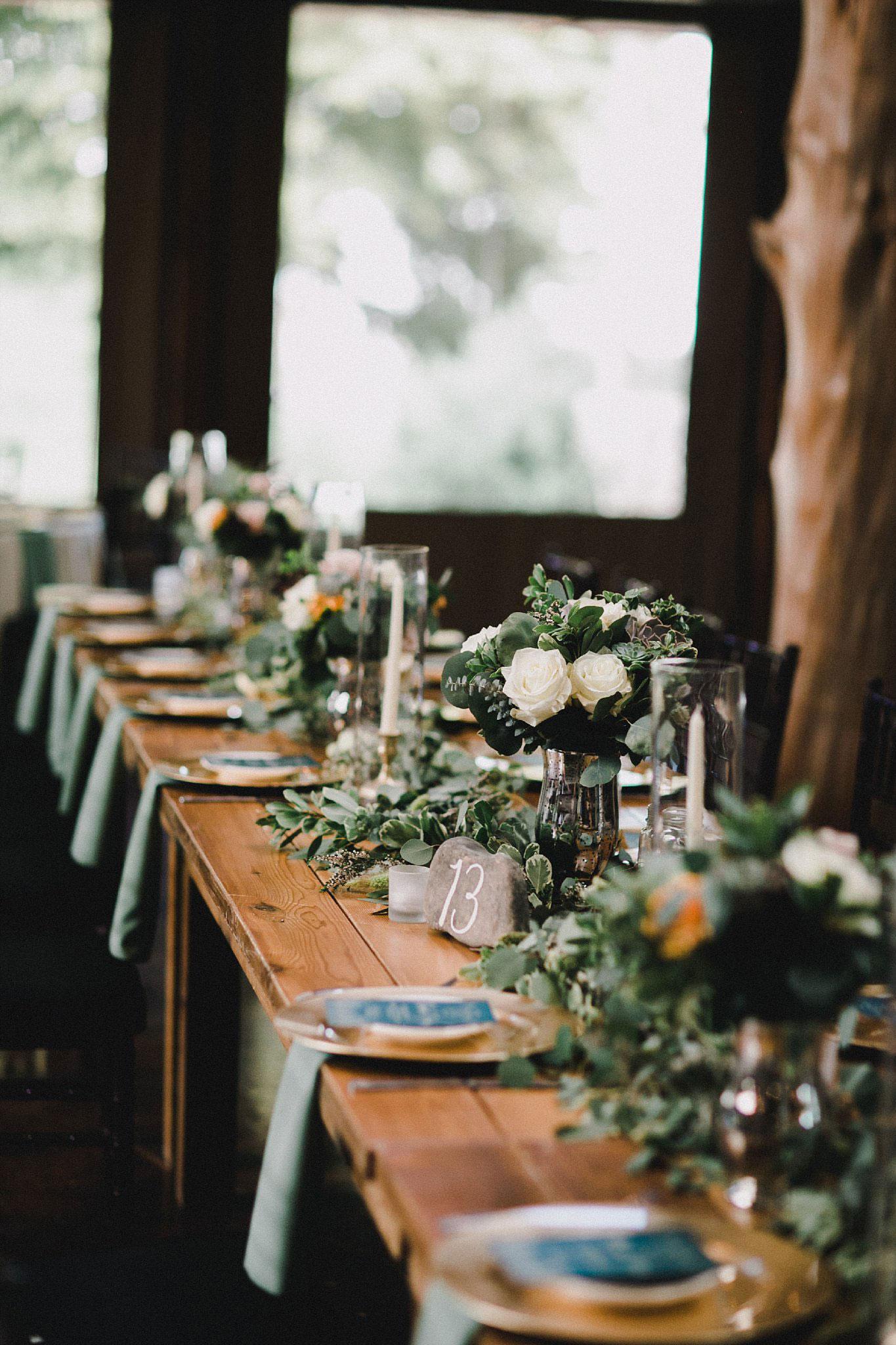Large greenery garland on wood head table
