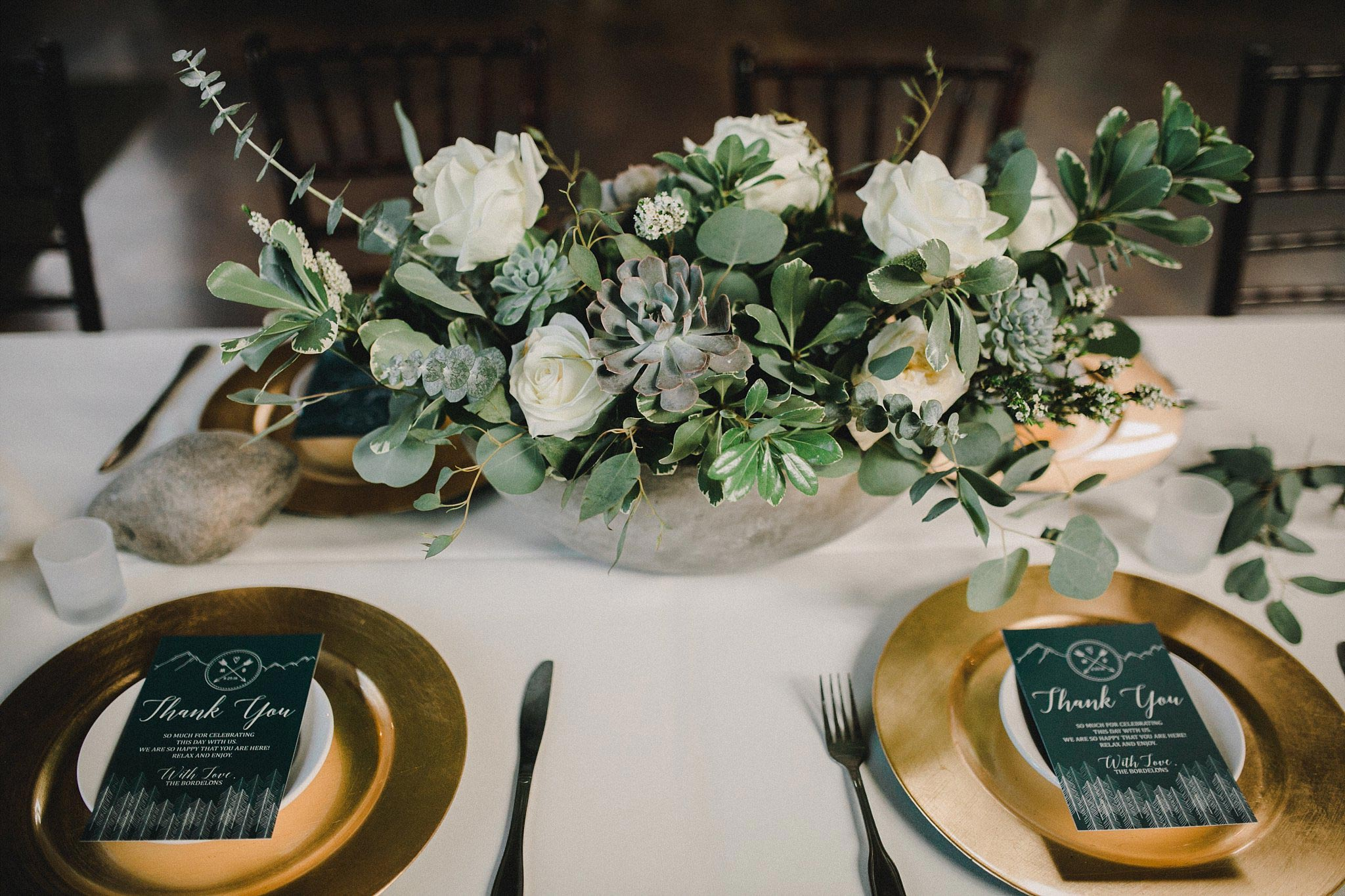 Organic white flowers, greenery, and succulent wedding flower arrangment in a concrete vase for a organic wedding at the brooks at weatherford
