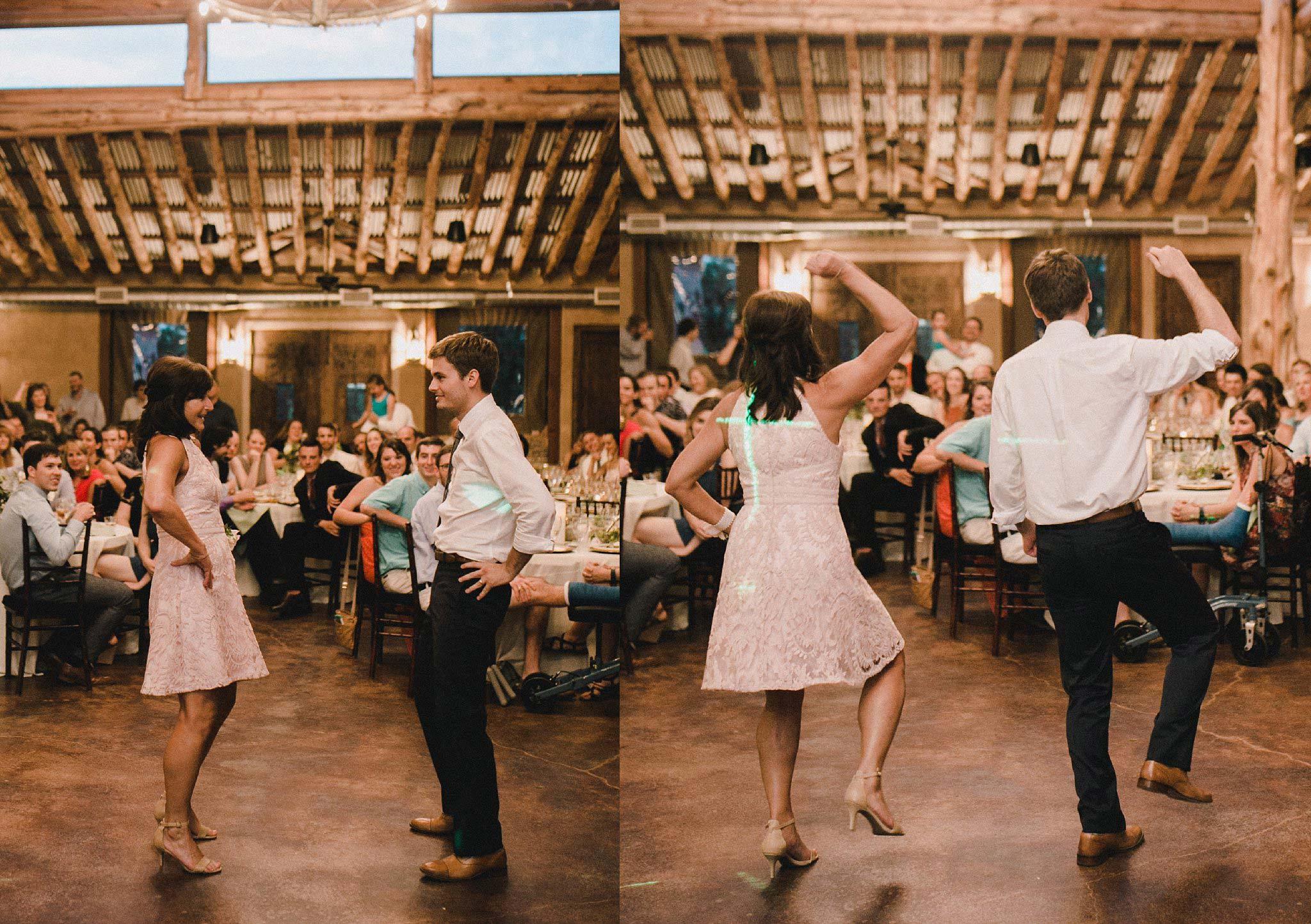 Groom and mom dancing at rustic wedding venue