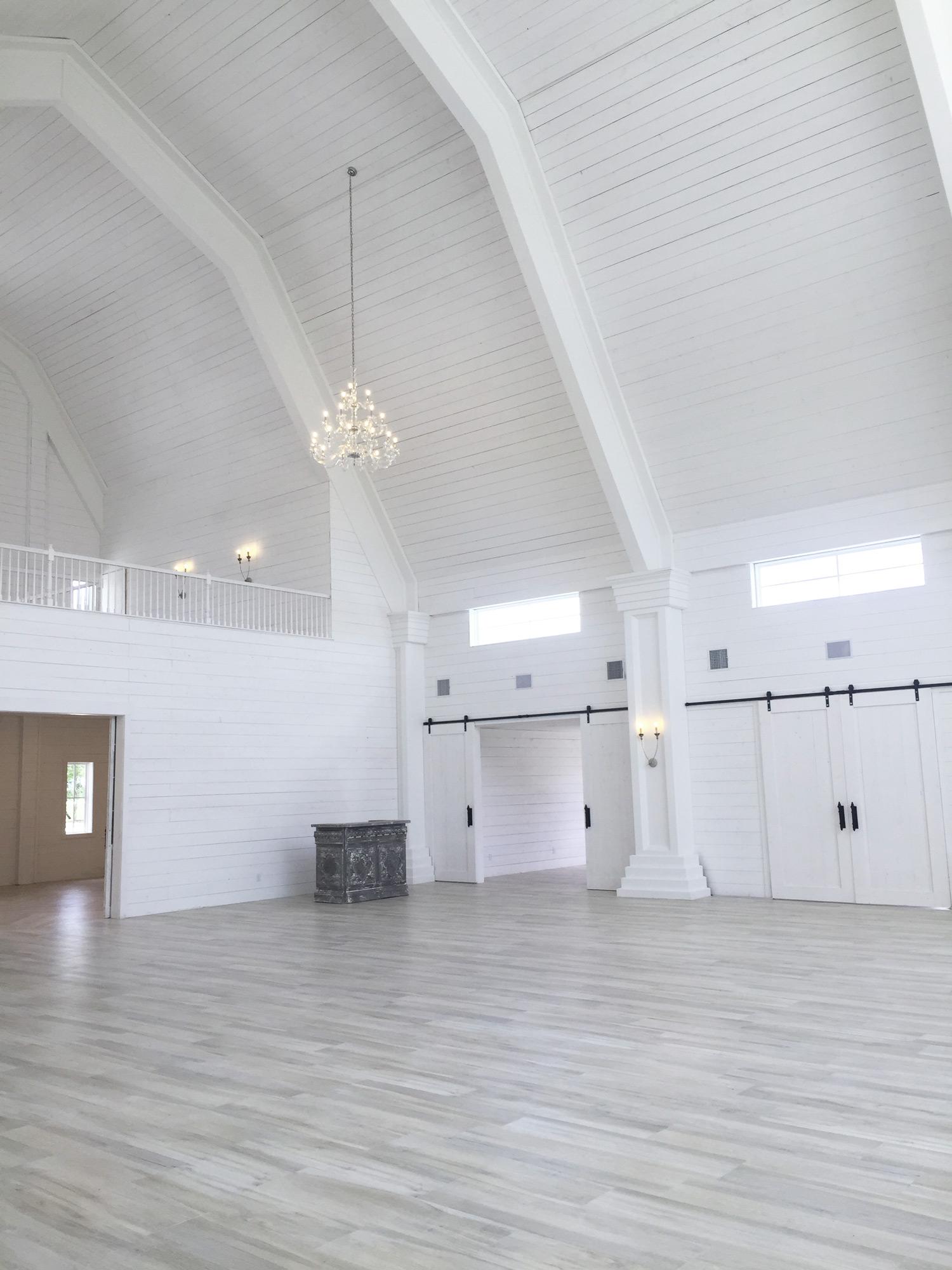 The Nest at Ruth Farms denton wedding venue's interior barn doors