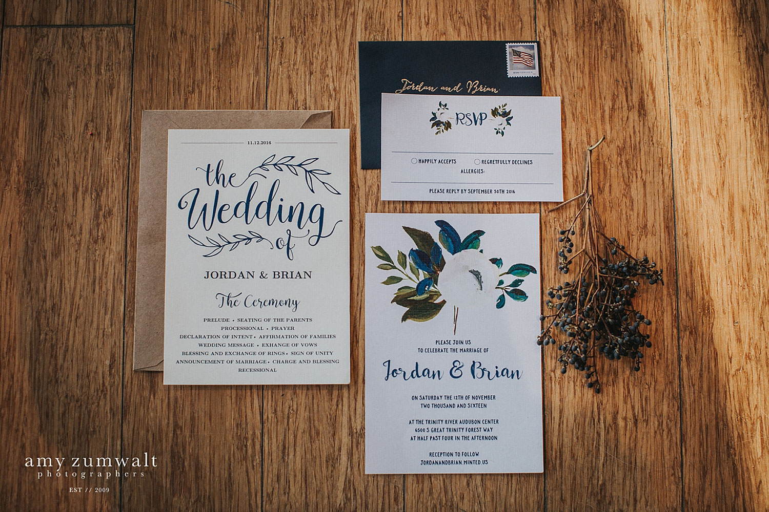Navy wedding invitation with a kraft paper envelope