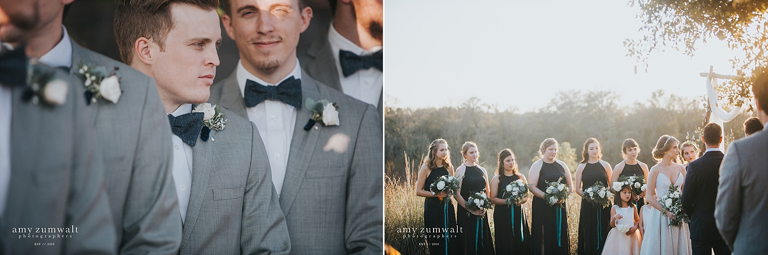 Groomsmen in grey suites wearing navy bowties