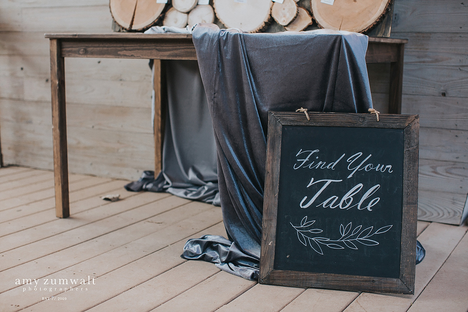 Velvet fabric and a chalk board sign
