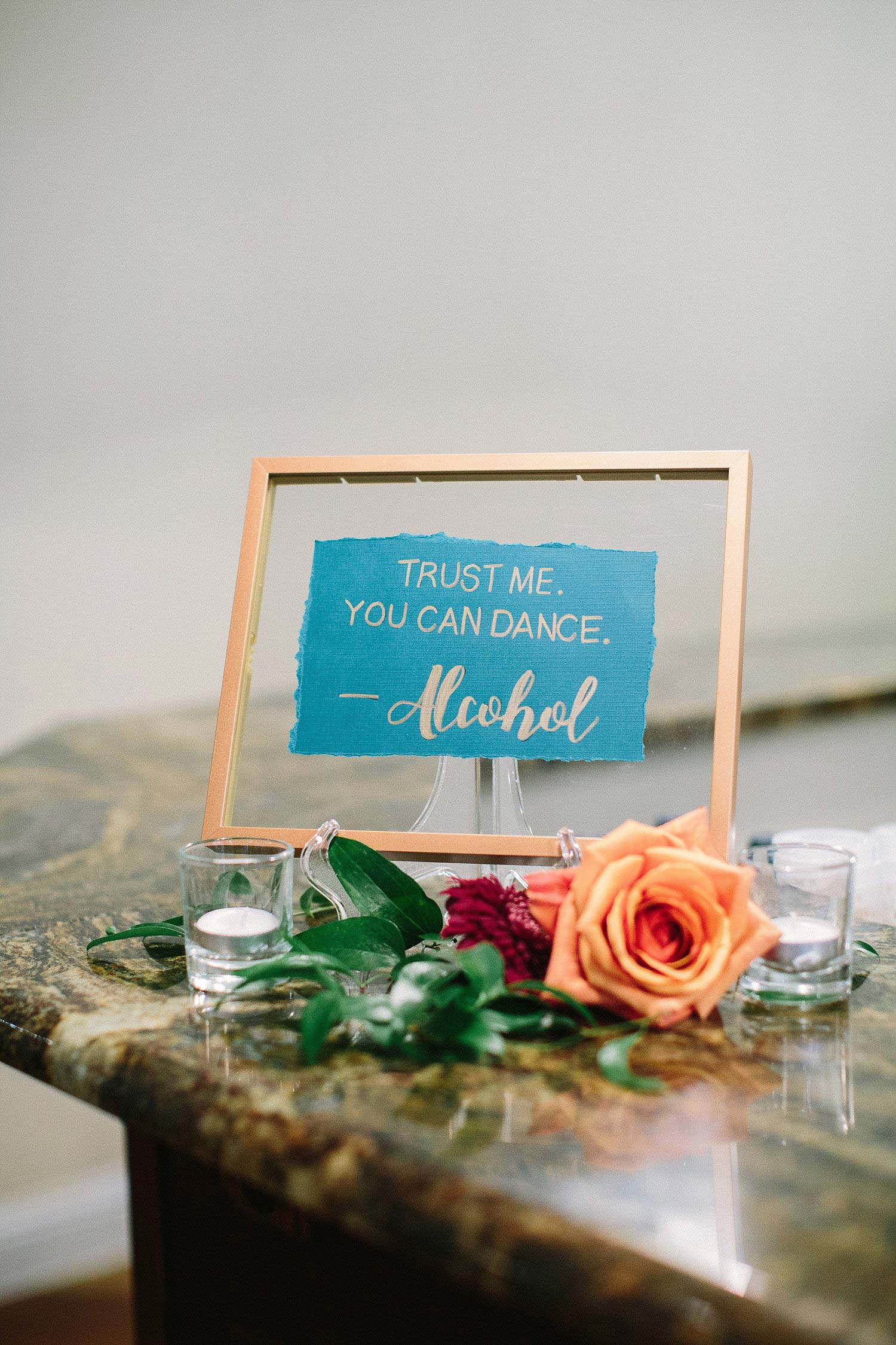 Blue sign with a copper float frame