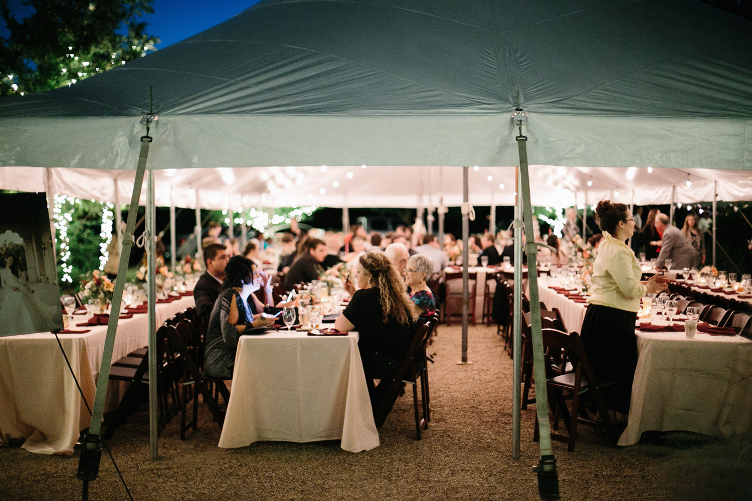 Texas tented wedding at night with hanging cafe lights