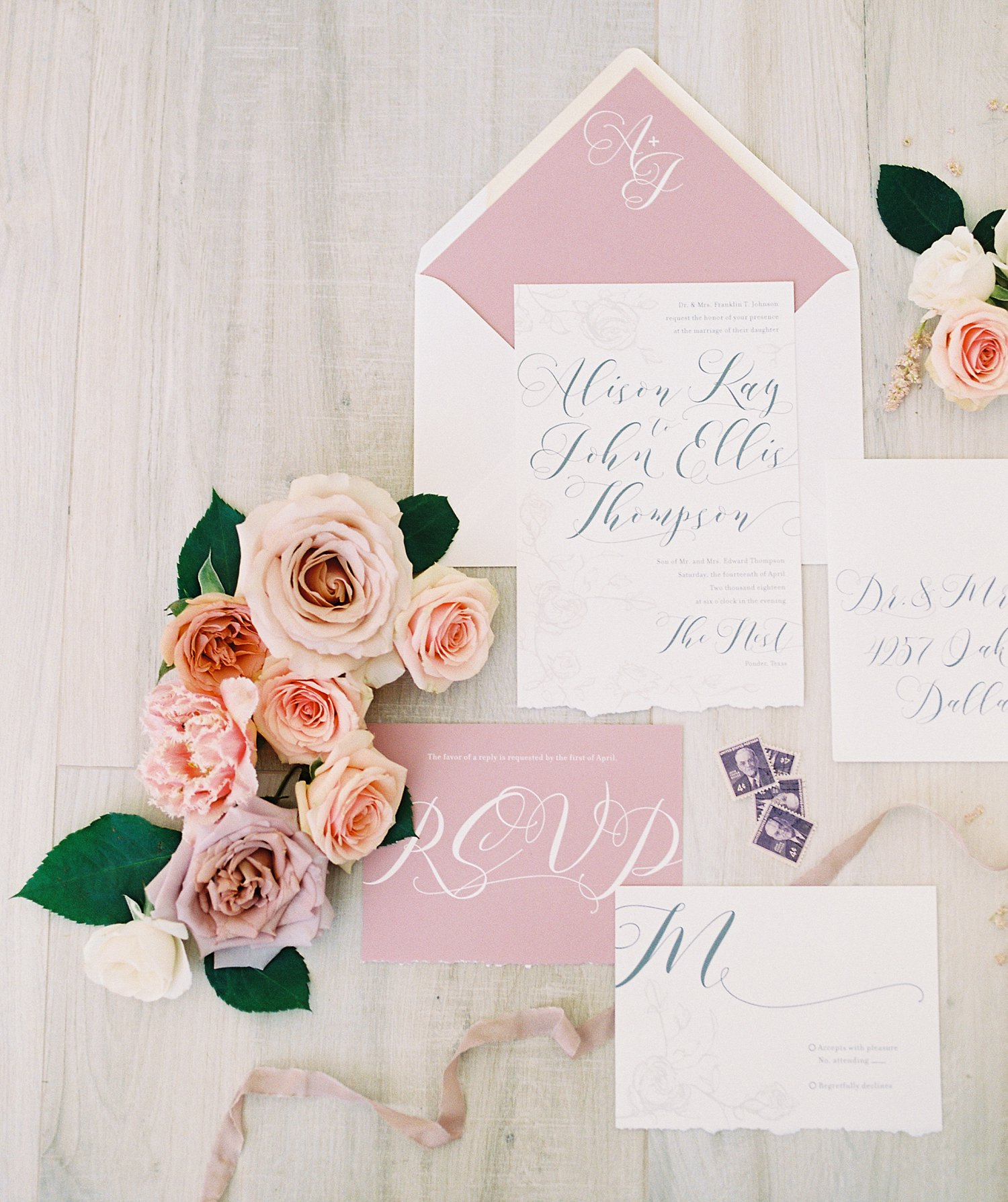 roses styling with wedding invitation