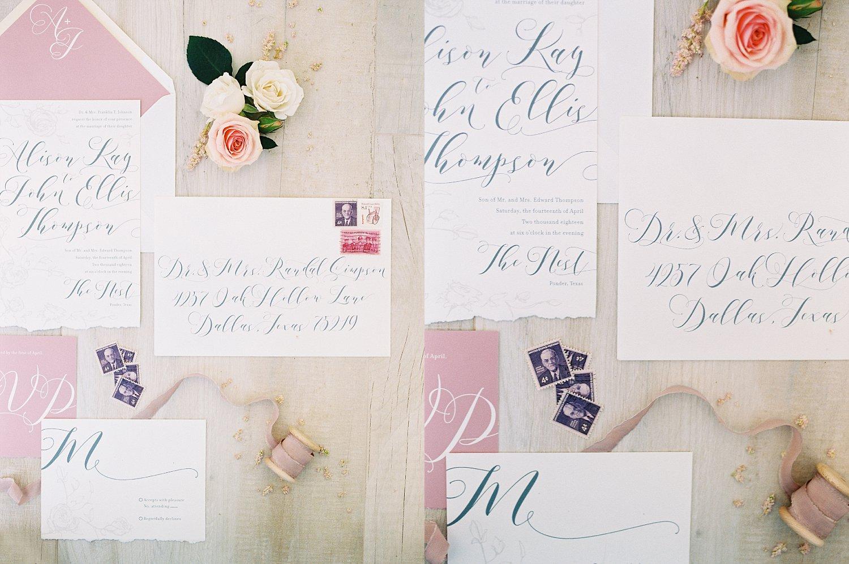 blue calligraphy on wedding invitation