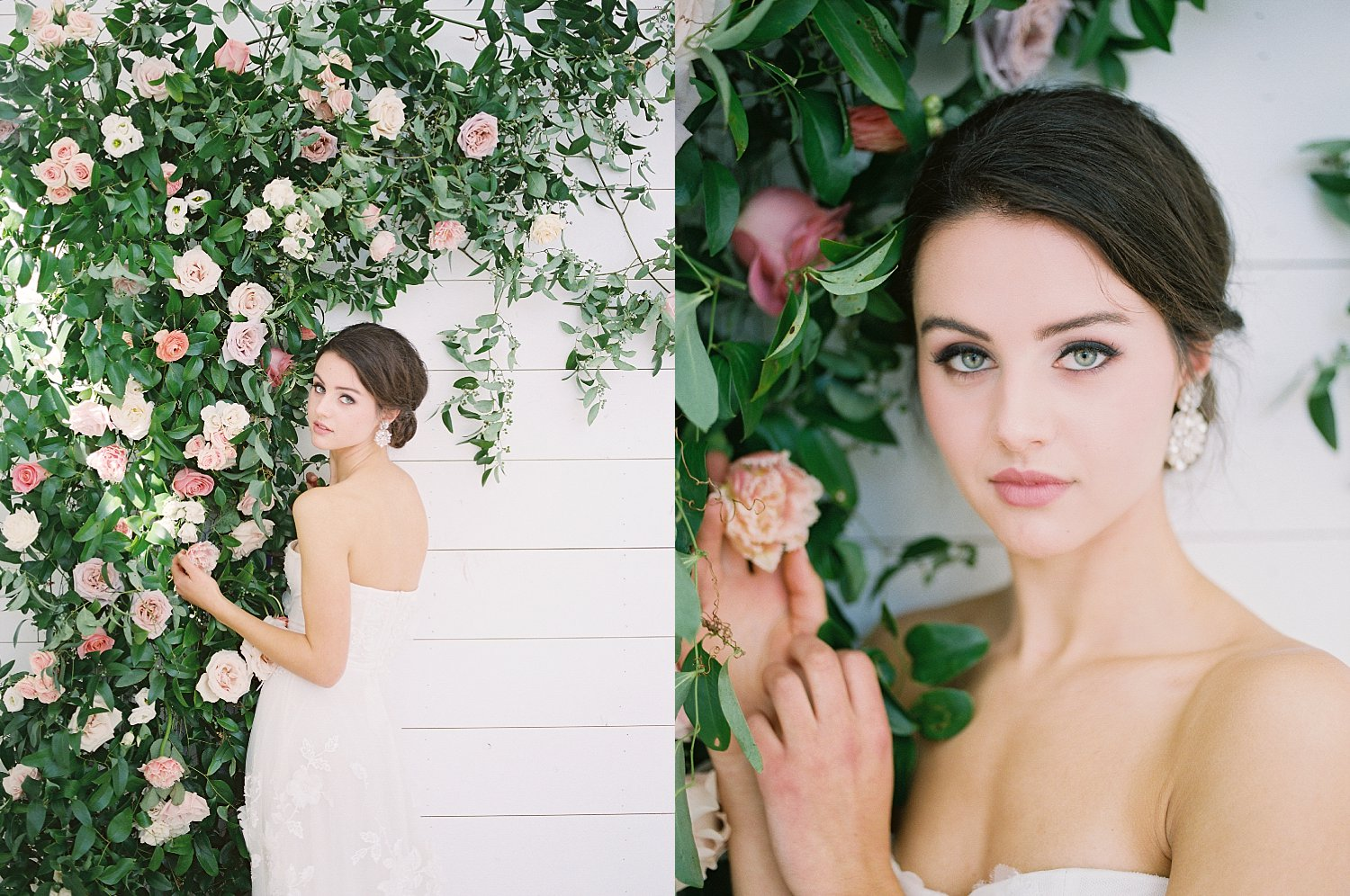 Bride smelling rose against white wall