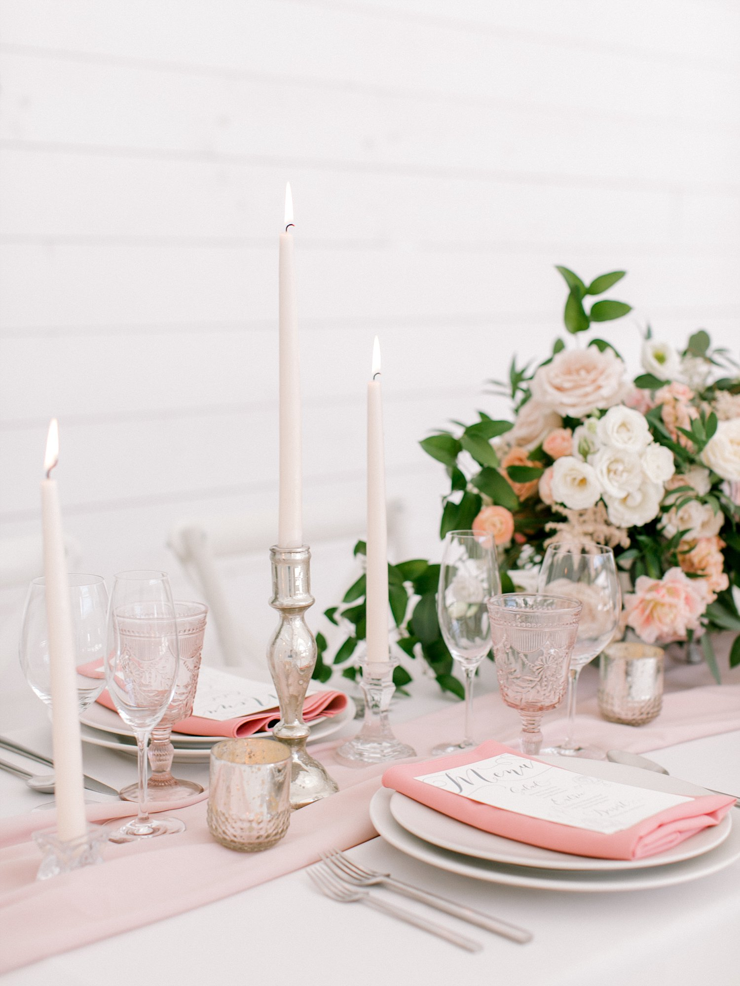 mauve napkin and a blush table runner on a white linen