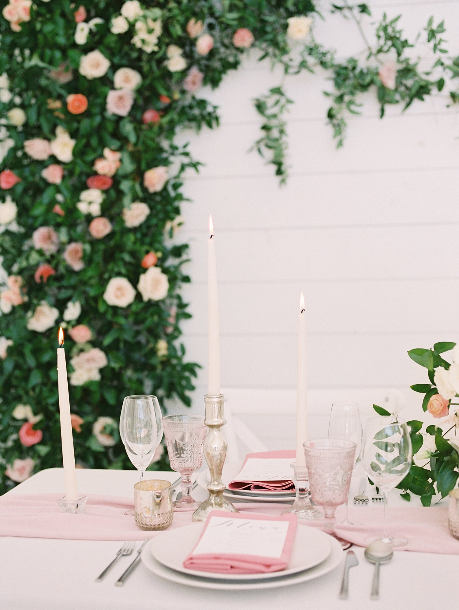 greenery and rose backdrop with a elegant tablescape