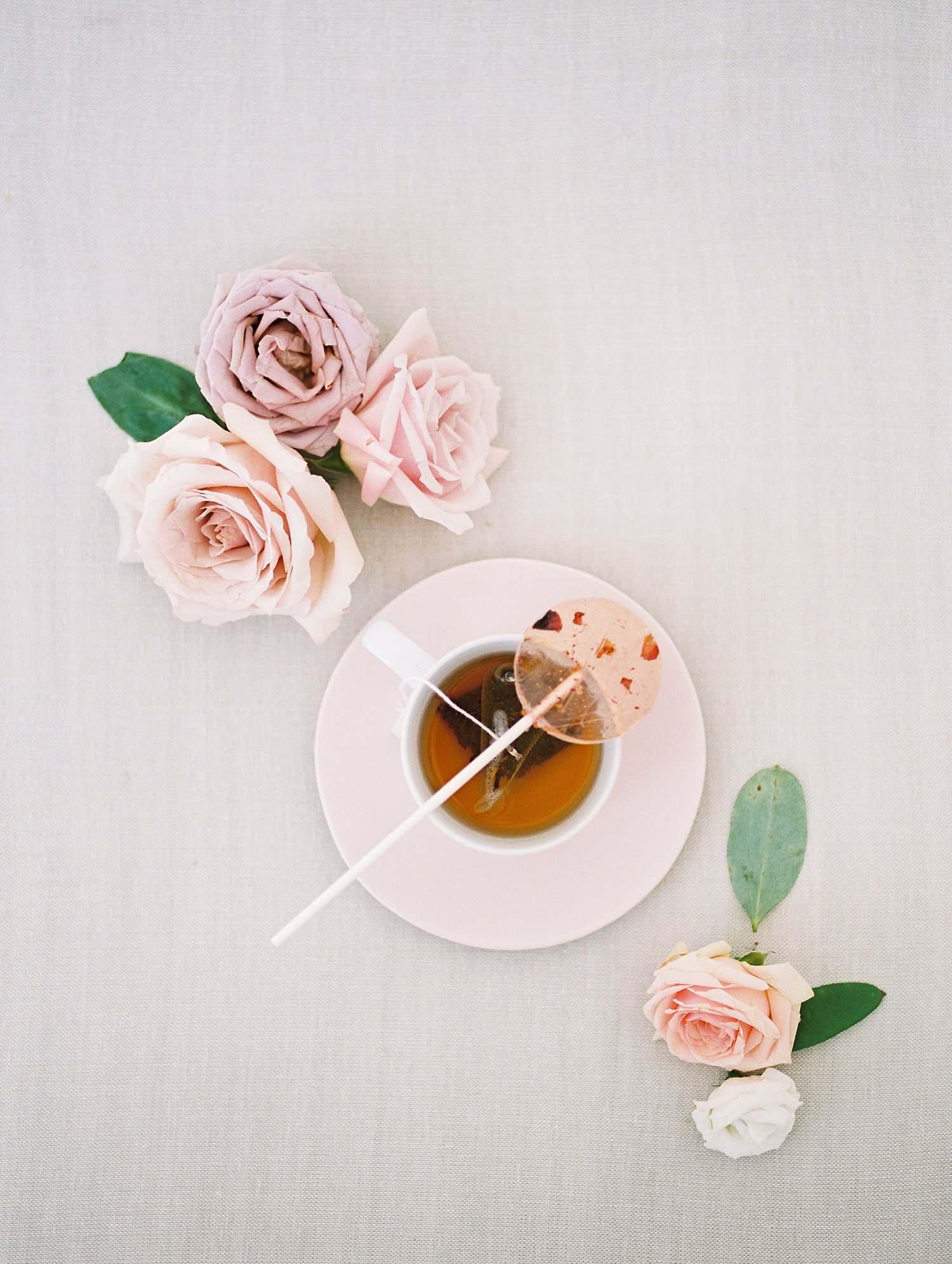 hot tea styled with a floral lollipop
