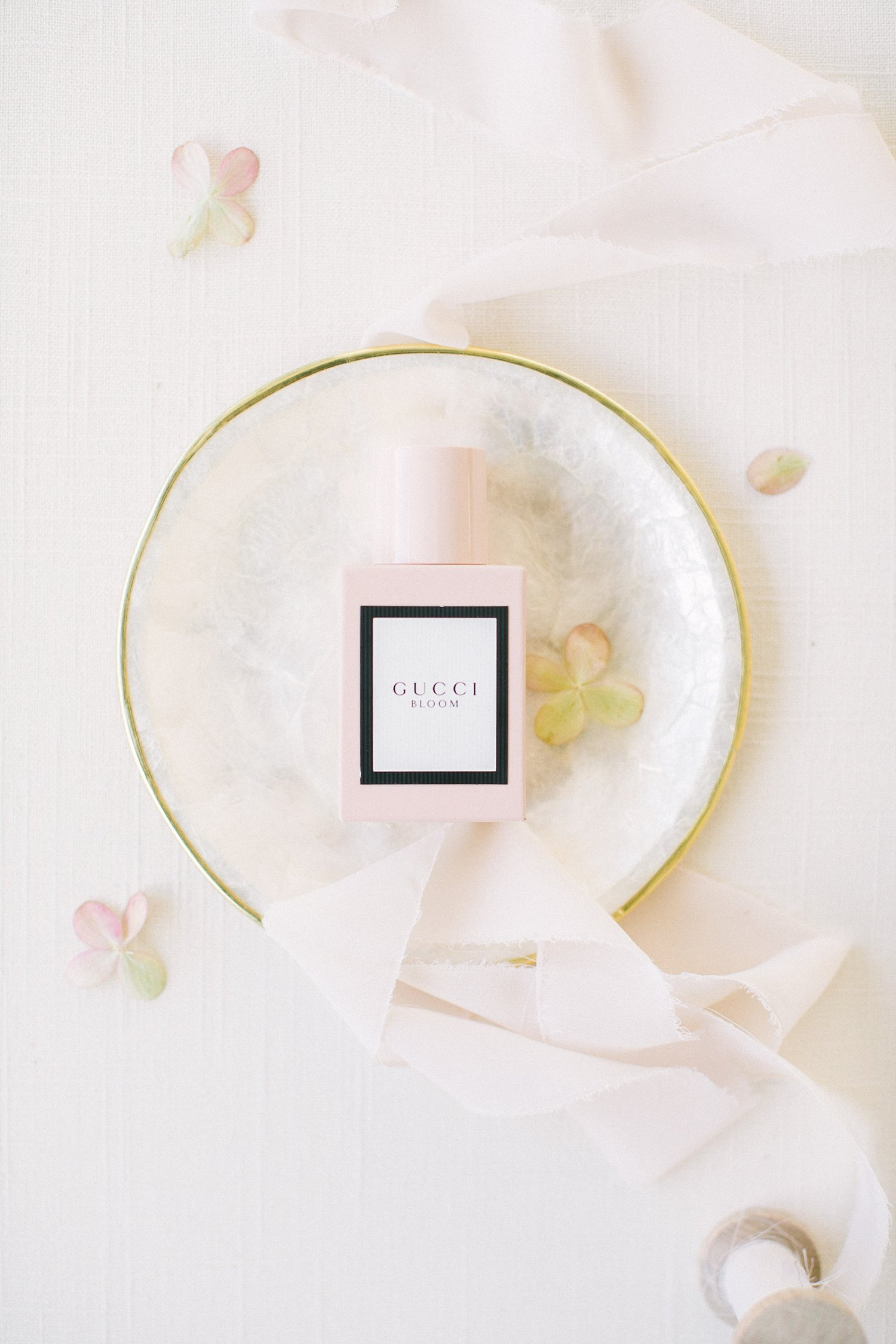 wedding perfume styled with ribbon and a marble tray