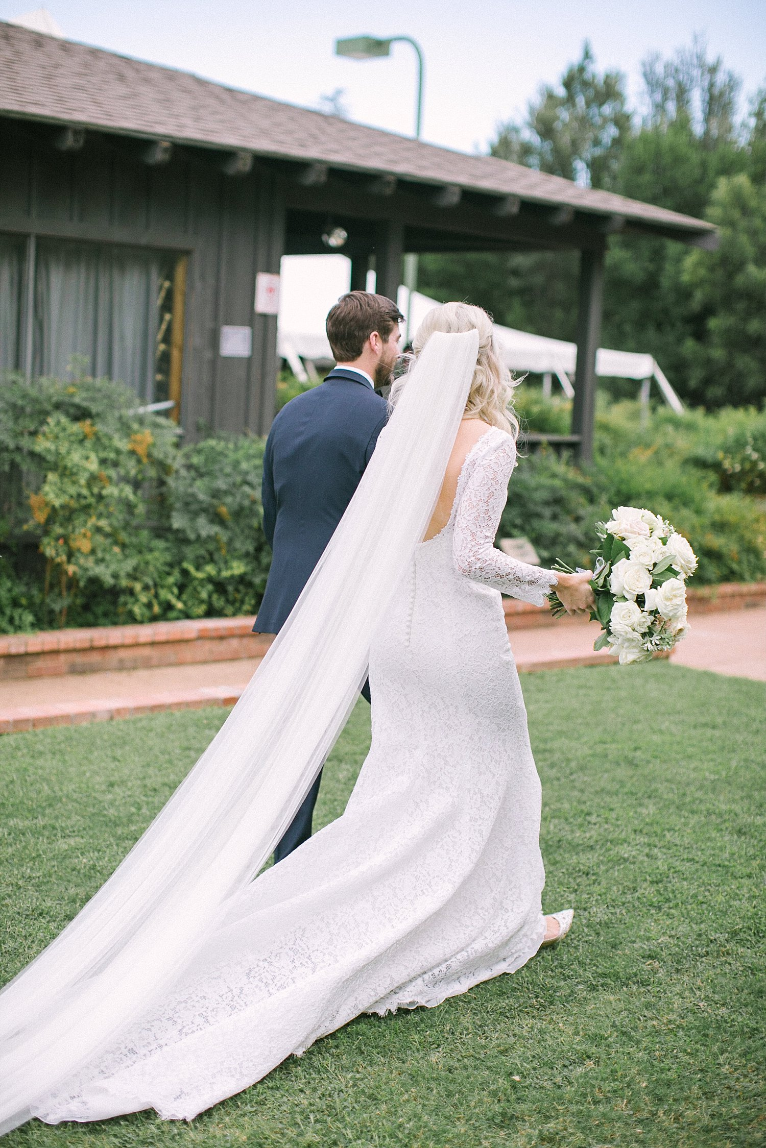 Bride and groom walking away at a outdoor wedding