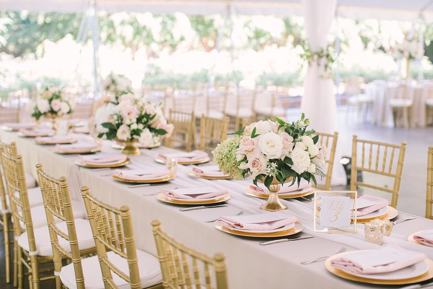 Long rectangle table with romantic flowers and blush napkins