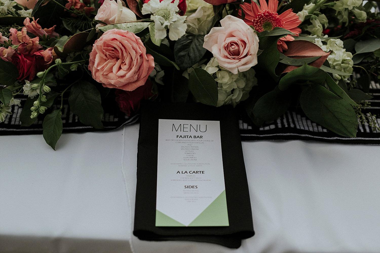 colorful geometric menu on a black napkin