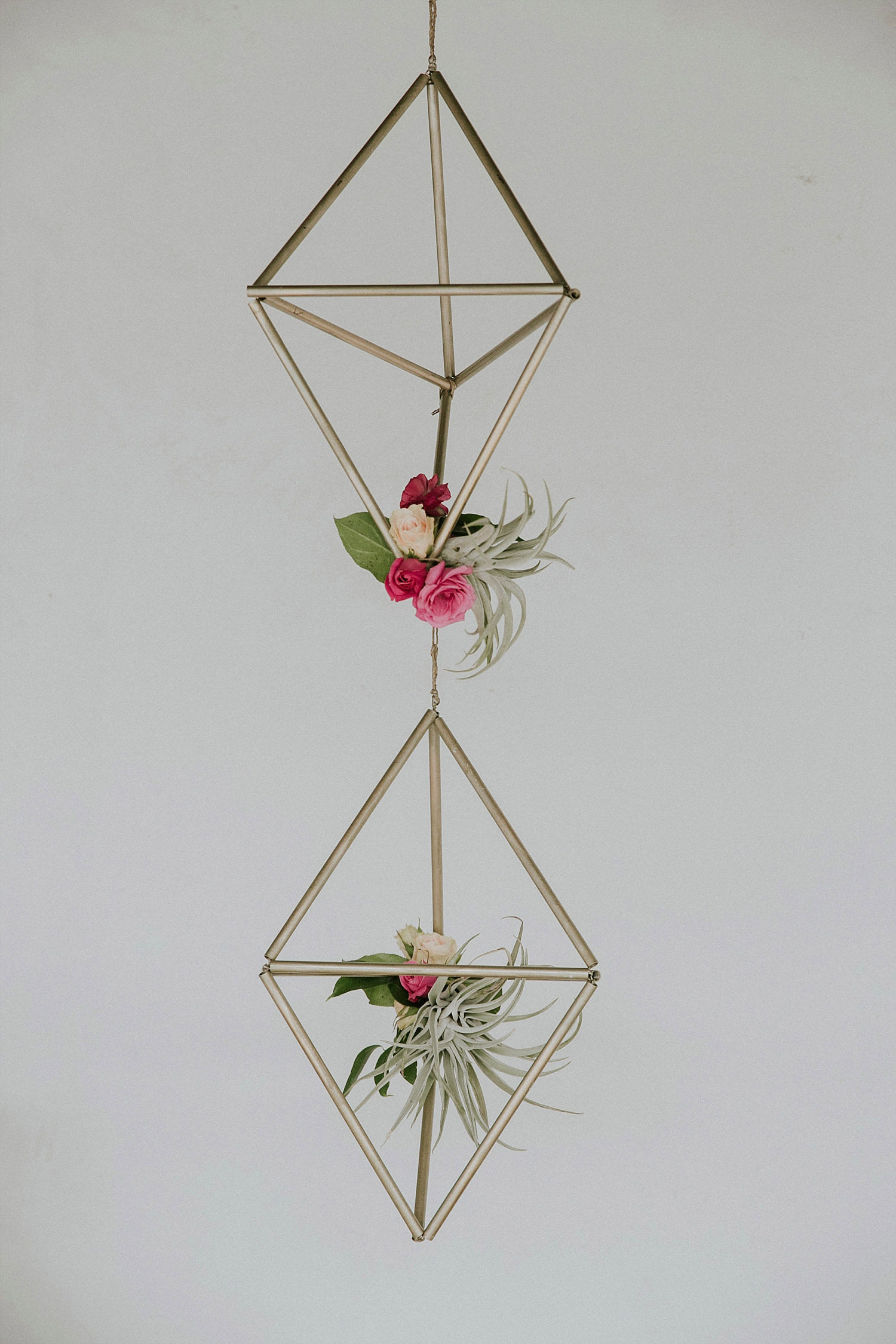 hanging geometric shapes with flowers